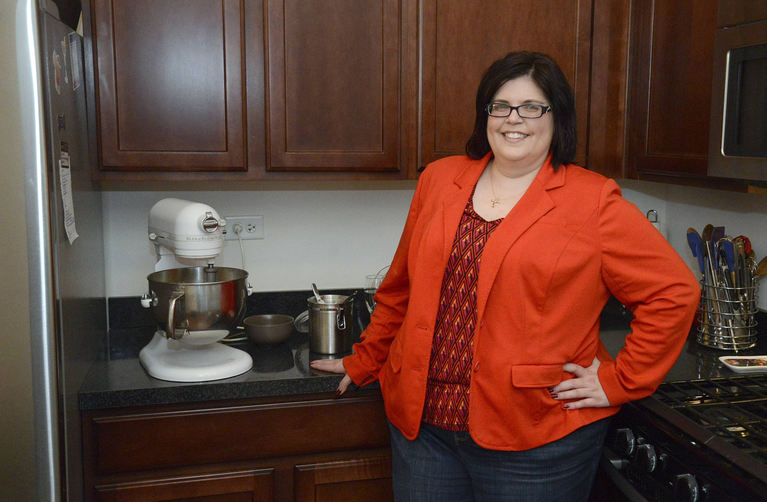 Christine Hernandez prepares meals for school children during the week and in her freetime decorates butter cookies for her FanCThatEvents decorative cookie shop on Etsy.