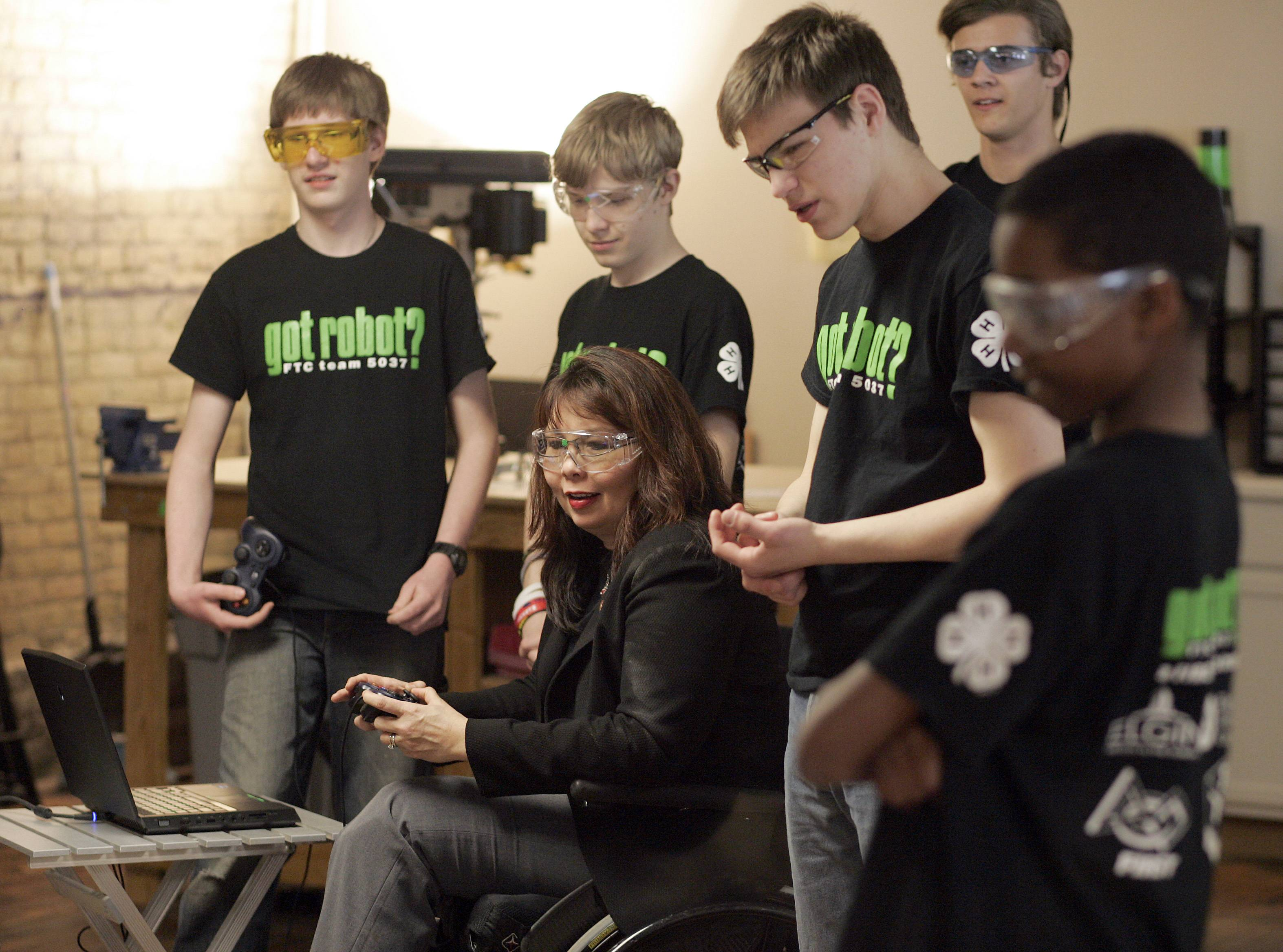 "U.S. Rep. Tammy Duckworth drives a robot called the ""Black Pearl"" Wednesday at the Elgin Technology Center. The robot was crated by the got robot? First Tech Challenge 5037 team. Duckworth was promoting the House Student App Challenge."