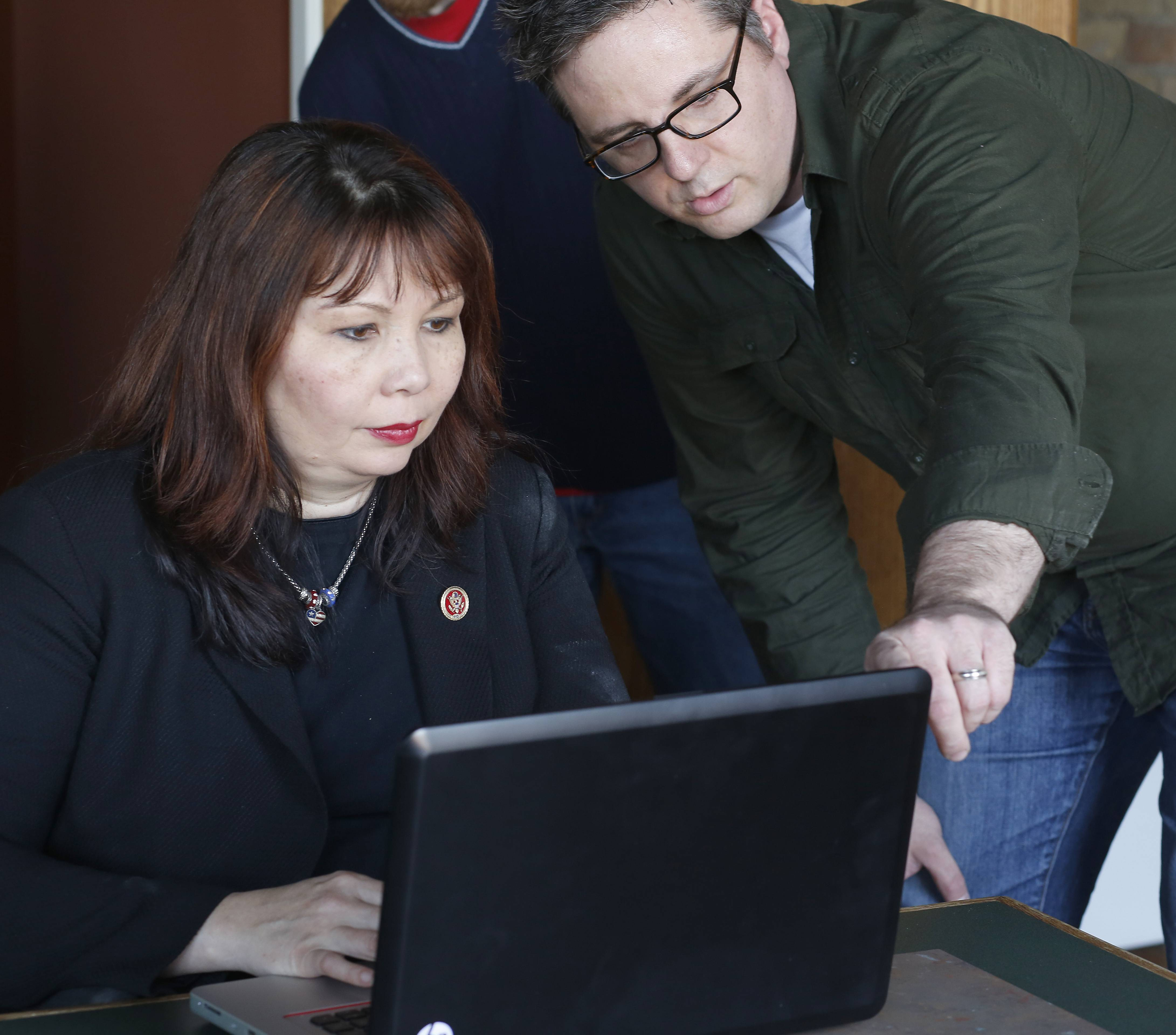 James Stubblefield, educational director for the Elgin Technology Center, shows U.S. Rep. Tammy Duckworth how to code an app Wednesday.
