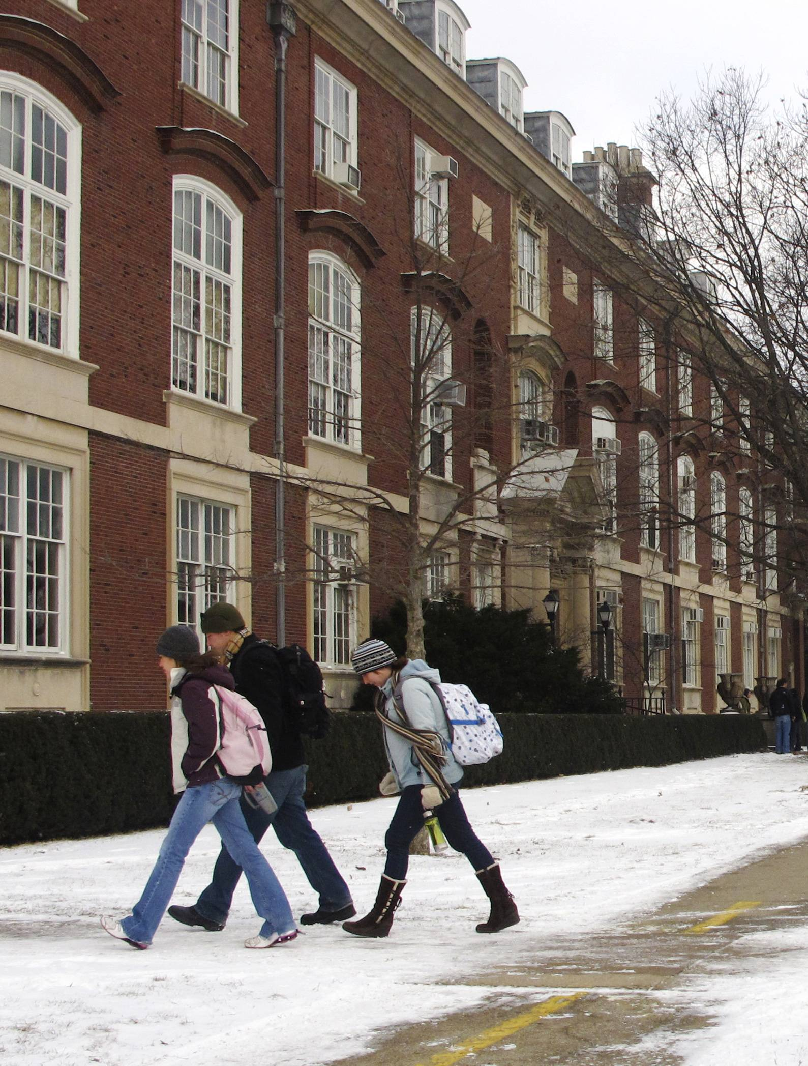 Students walk toward the Architecture Building on the University of Illinois campus in Champaign. A review of University of Illinois finances shows the school has brought in more money than it has spent since 2013. But it has put off more than a billion dollars in maintenance.