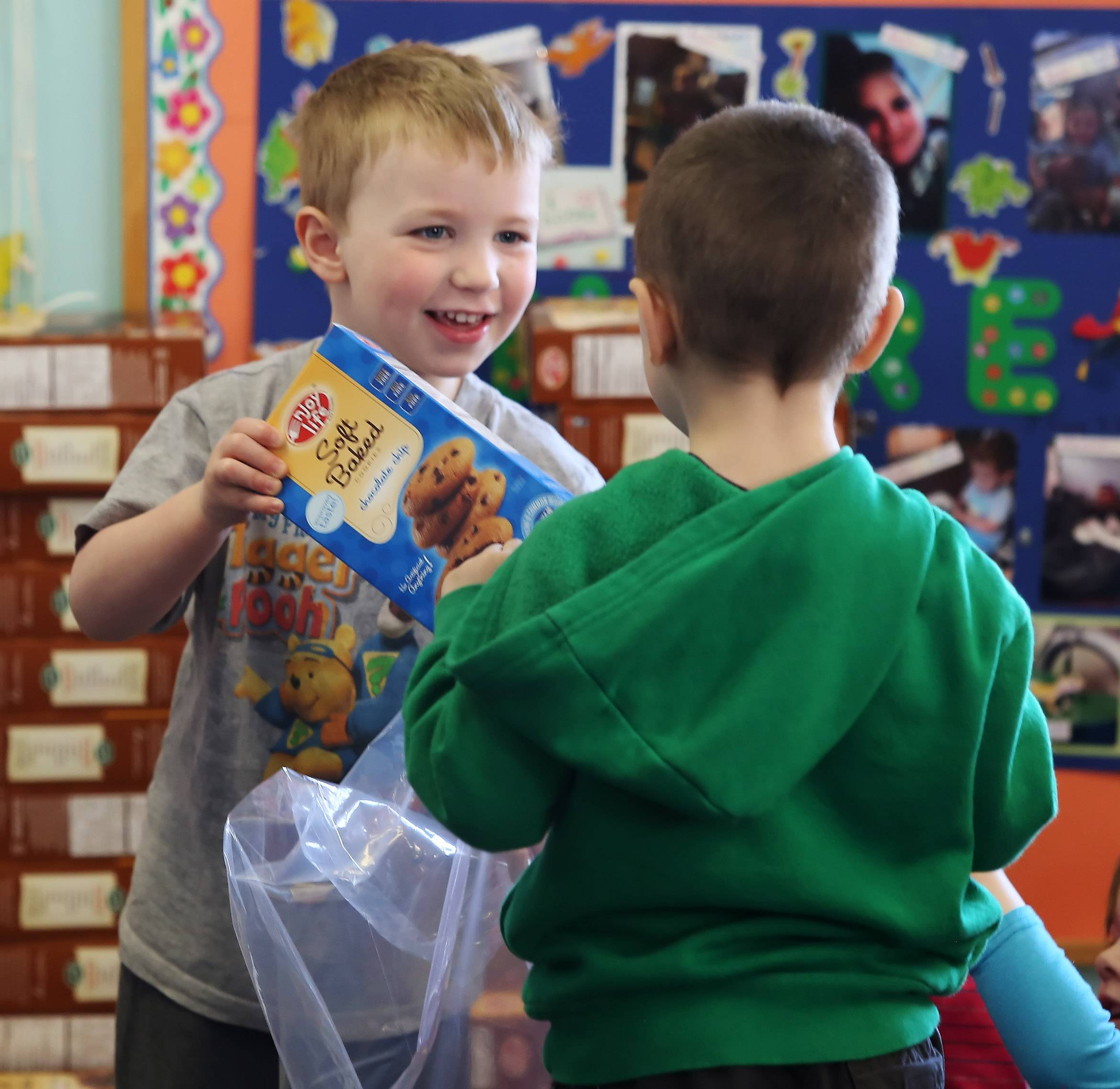 Preschoolers Cael Cramond, left, and Jakob Halperin make spring baskets Tuesday at the Lindenhurst Early Childhood Center. Five hundred baskets will be distributed to less fortunate children through Lake County Housing Authority, area food pantries, PADS and other groups.