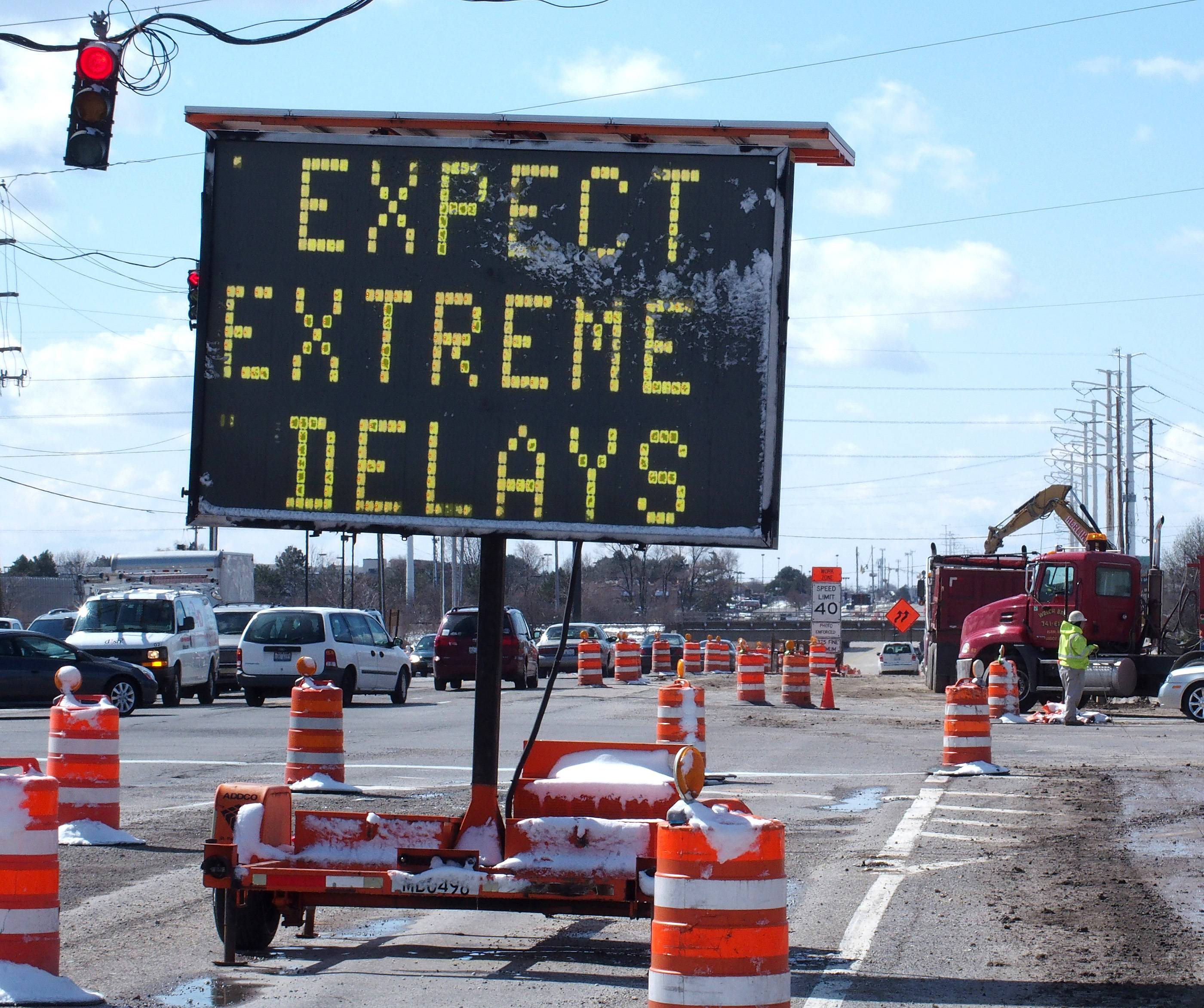 Road signs warn drivers of delays expected to begin Monday on Route 59 in Naperville and Aurora as the road is reduced to one lane in each direction under the BNSF railroad tracks between North Aurora Road and Glacier Park Avenue/Meridian Parkway.