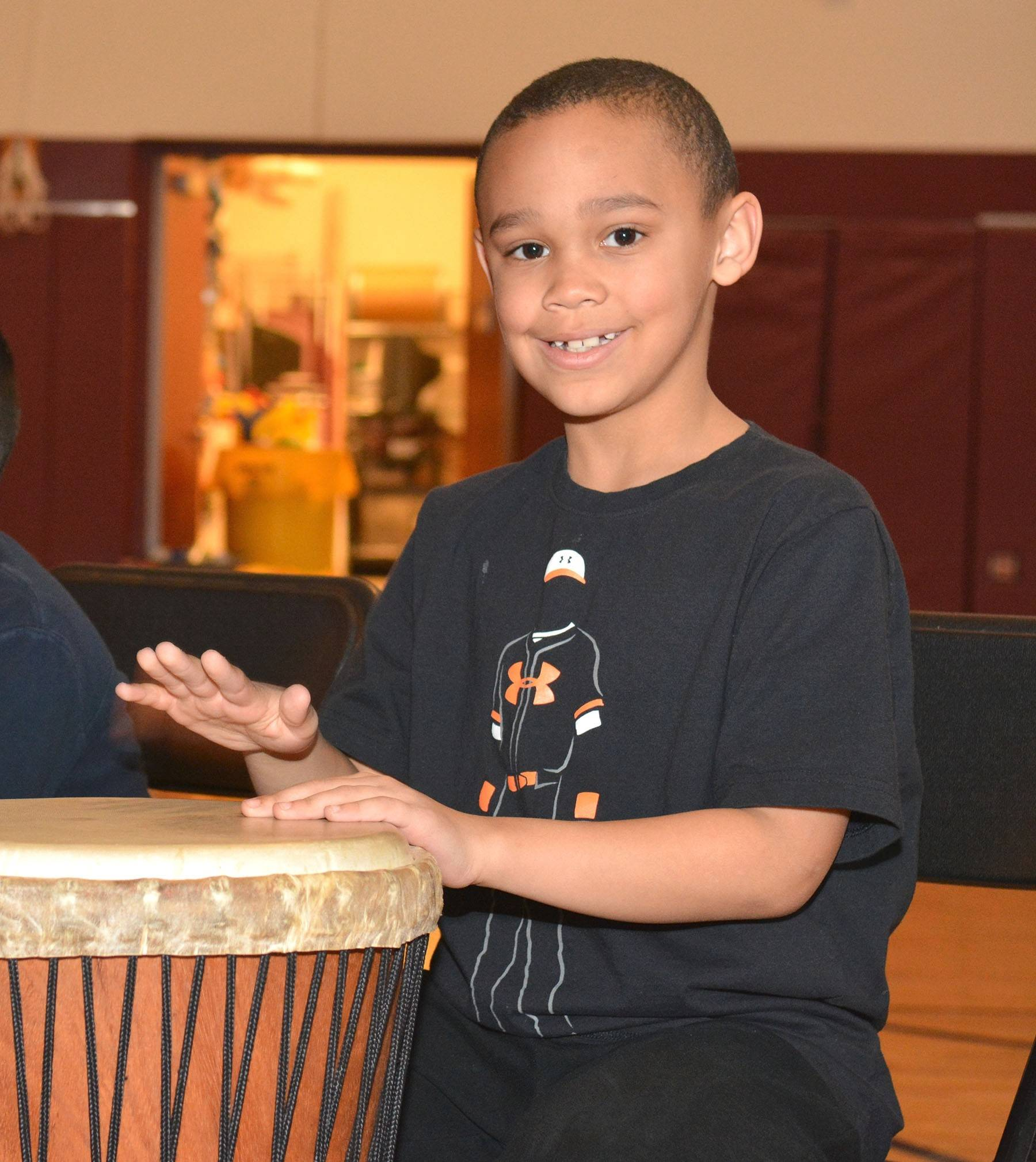 Lucas Adams takes part in the drumming program at Townline Elementary School in Vernon Hills.