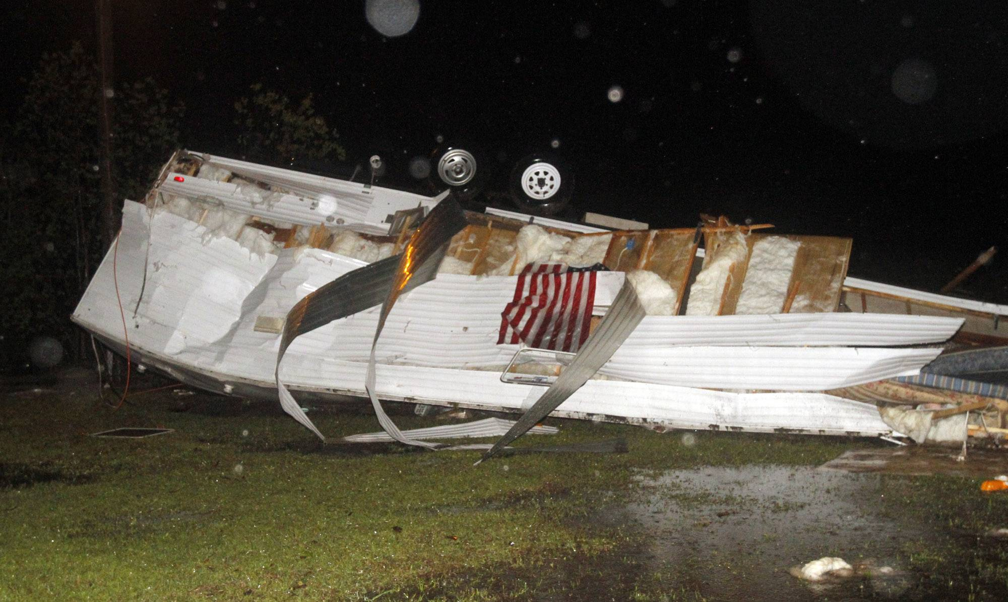 Campers at Santa Maria RV Park on Martin Bluff Road in Gautier, Miss., were flipped from possible straight line winds Monday, April 14, 2014, as storms rolled over the coast. As many as 30 campers were damaged from the storm.