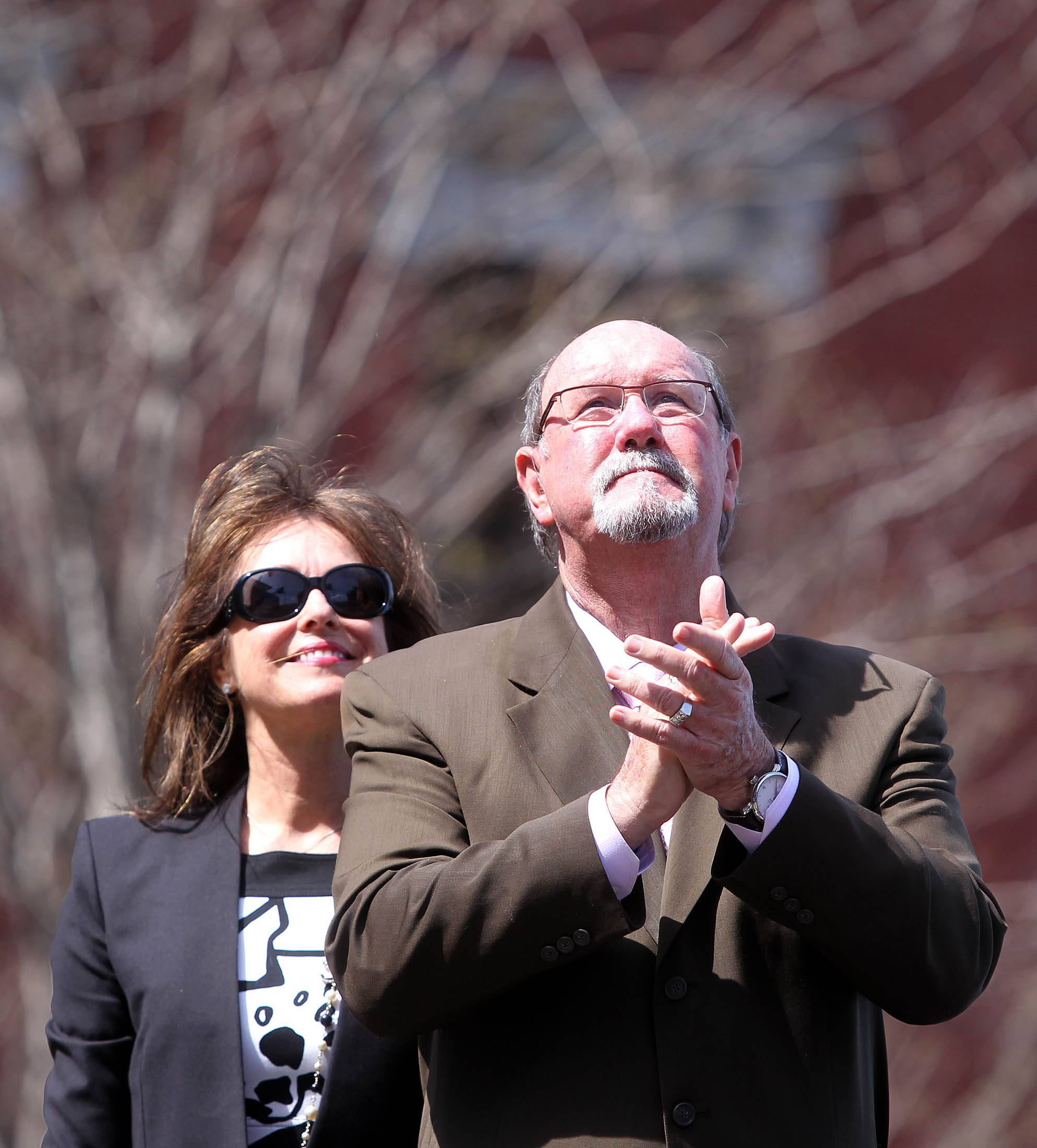 Boston Marathon bombing survivor John Odom stands with his wife, Karen, Monday during a flag-raising ceremony at Boston Medical Center.