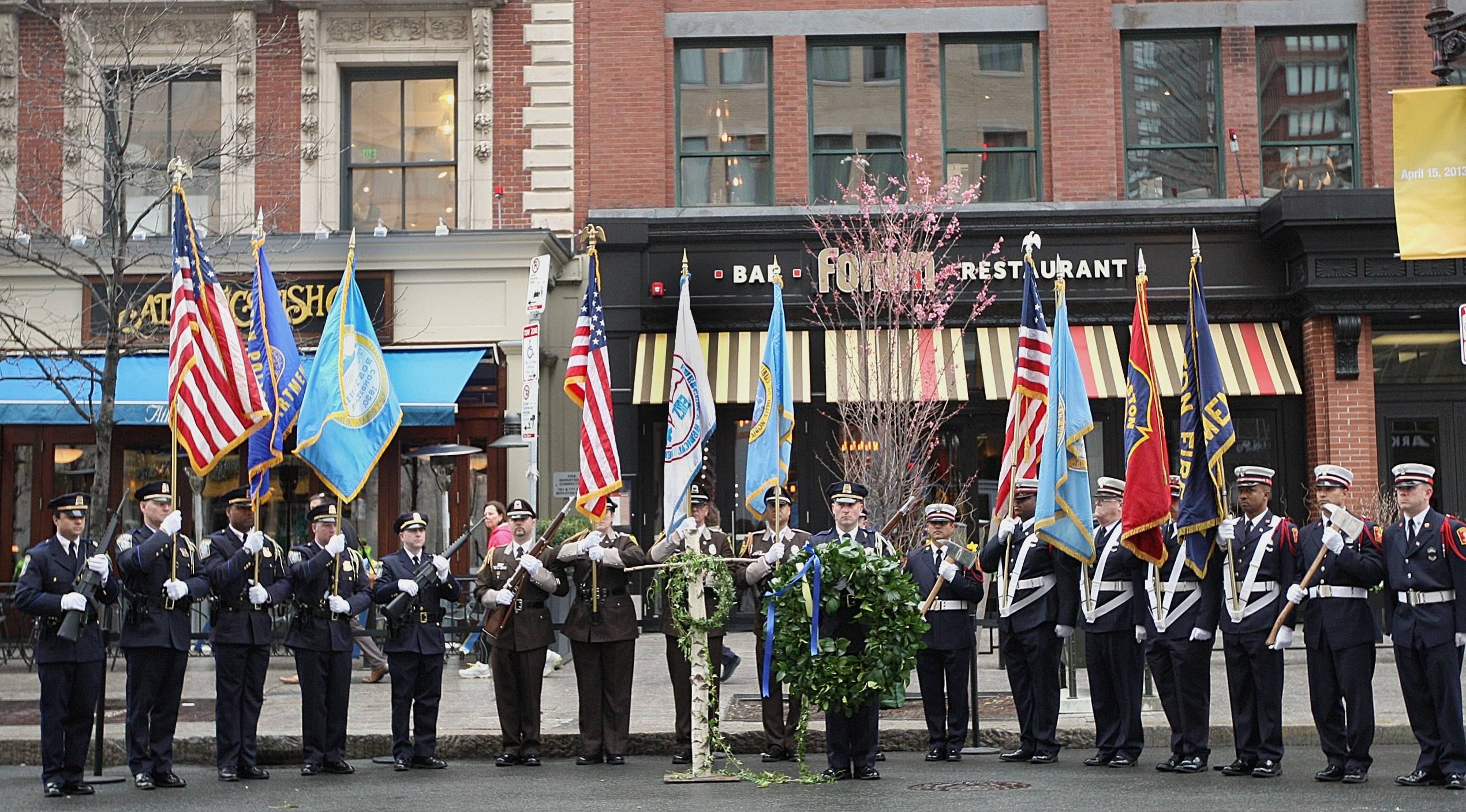 Honor Guard members line up Tuesday in front of the Forum Restaurant in Copley Square, where a wreath-laying ceremony was held to commemorate the one year anniversary of the Boston Marathon bombings.