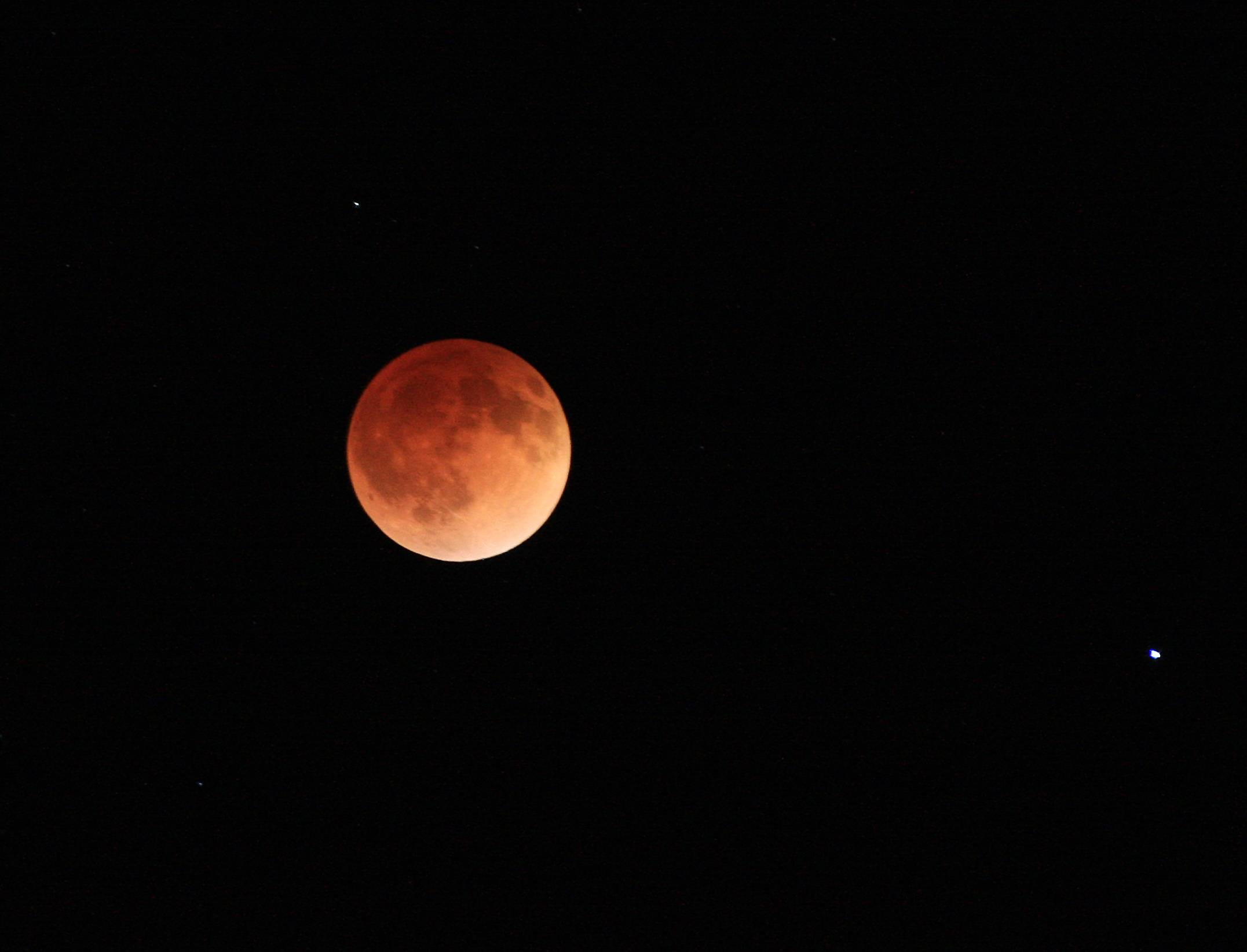 The moon glows a red hue during a total lunar eclipse Tuesday, April 15, 2014, as seen from the Billings, Mont., area. Tuesday's eclipse is the first of four total lunar eclipses that will take place between 2014 to 2015.