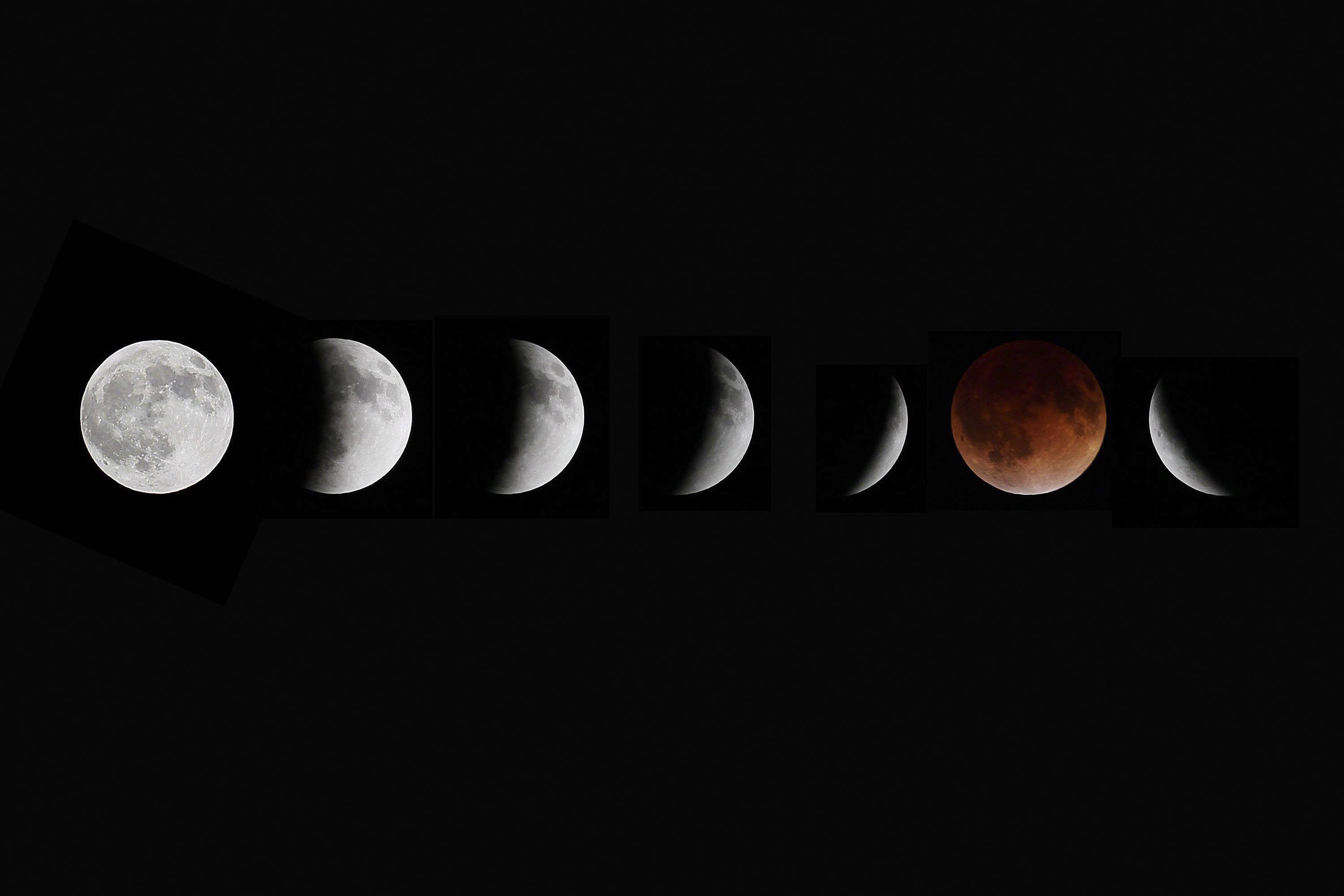This composite photo shows multiple images of the moon during the stages of a lunar eclipse, as seen from Winnipeg, Manitoba, Tuesday, April 15, 2014.