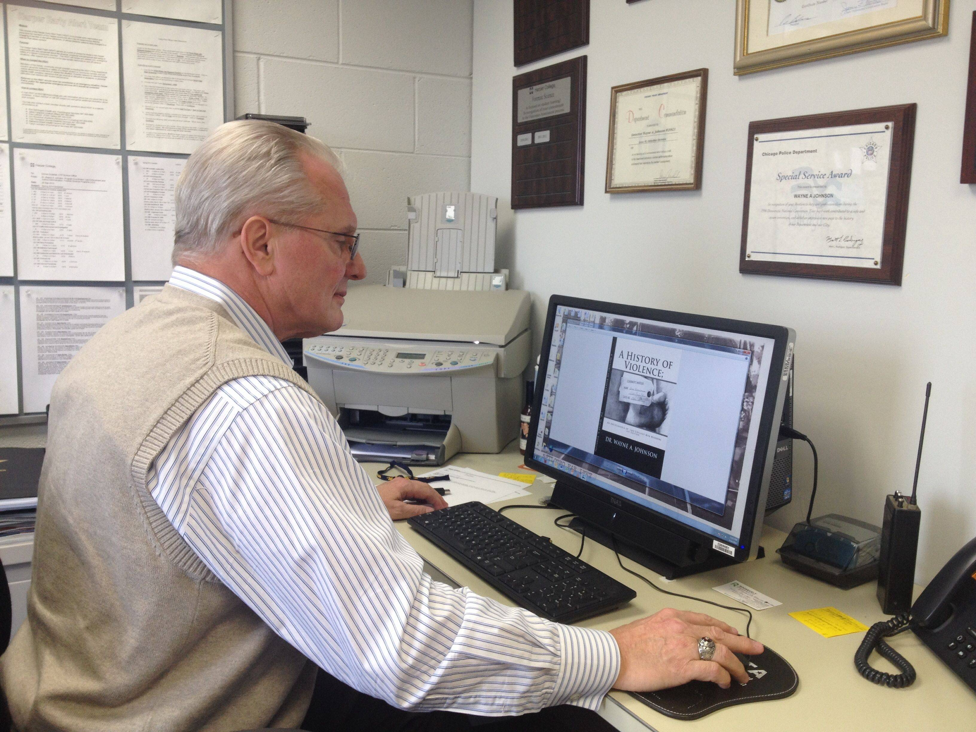 In his office at Harper College, professor Wayne A. Johnson pulls up the computer image of his new book about the mob. Johnson chronicles more than 1,400 mob murders spanning more than a century.