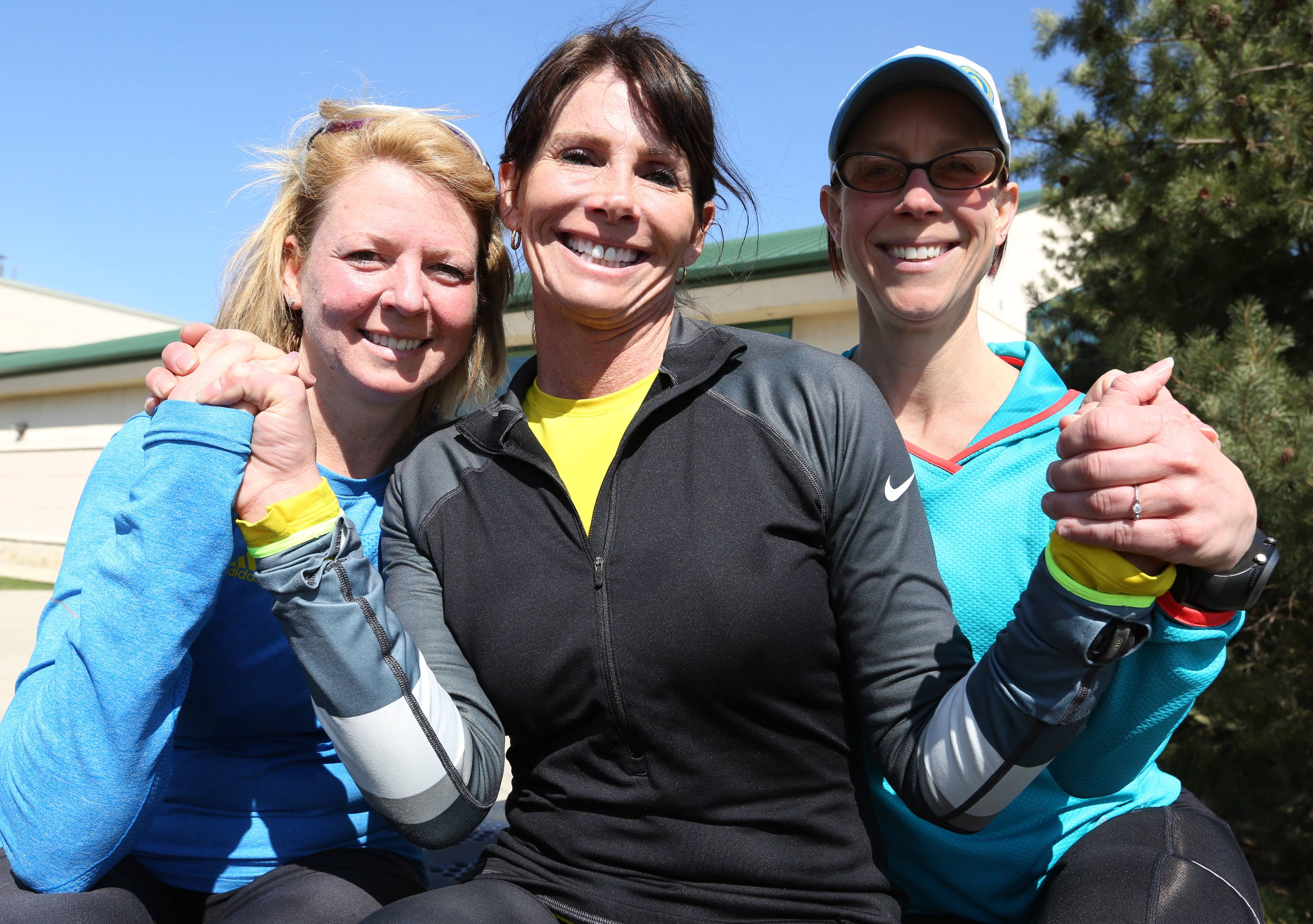 Brenda Zeck of Third Lake, from left, Sue Balthazor of Gurnee and Lisa Strong of Grayslake take a training run near Gurnee. All three ran the Boston Marathon last year, and Zeck and Balthazor will return to run it Monday.