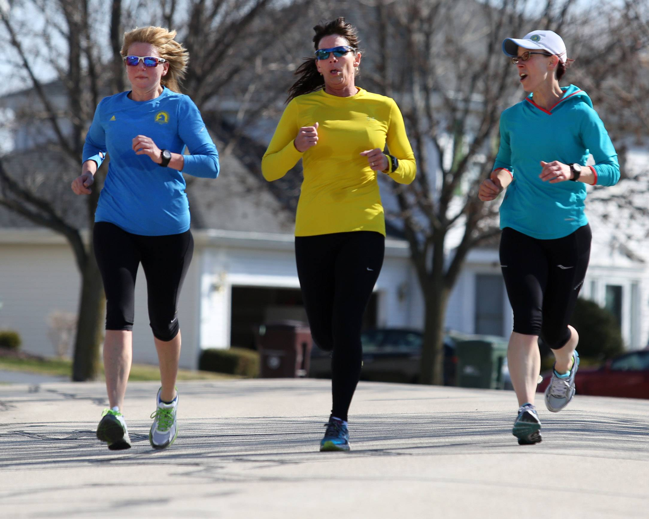 From left, Brenda Zeck of Third Lake, Sue Balthazor of Gurnee and Lisa Strong of Grayslake take a training run near Gurnee. All three ran the Boston Marathon last year and Zeck and Balthazor will be returning to run it Monday.