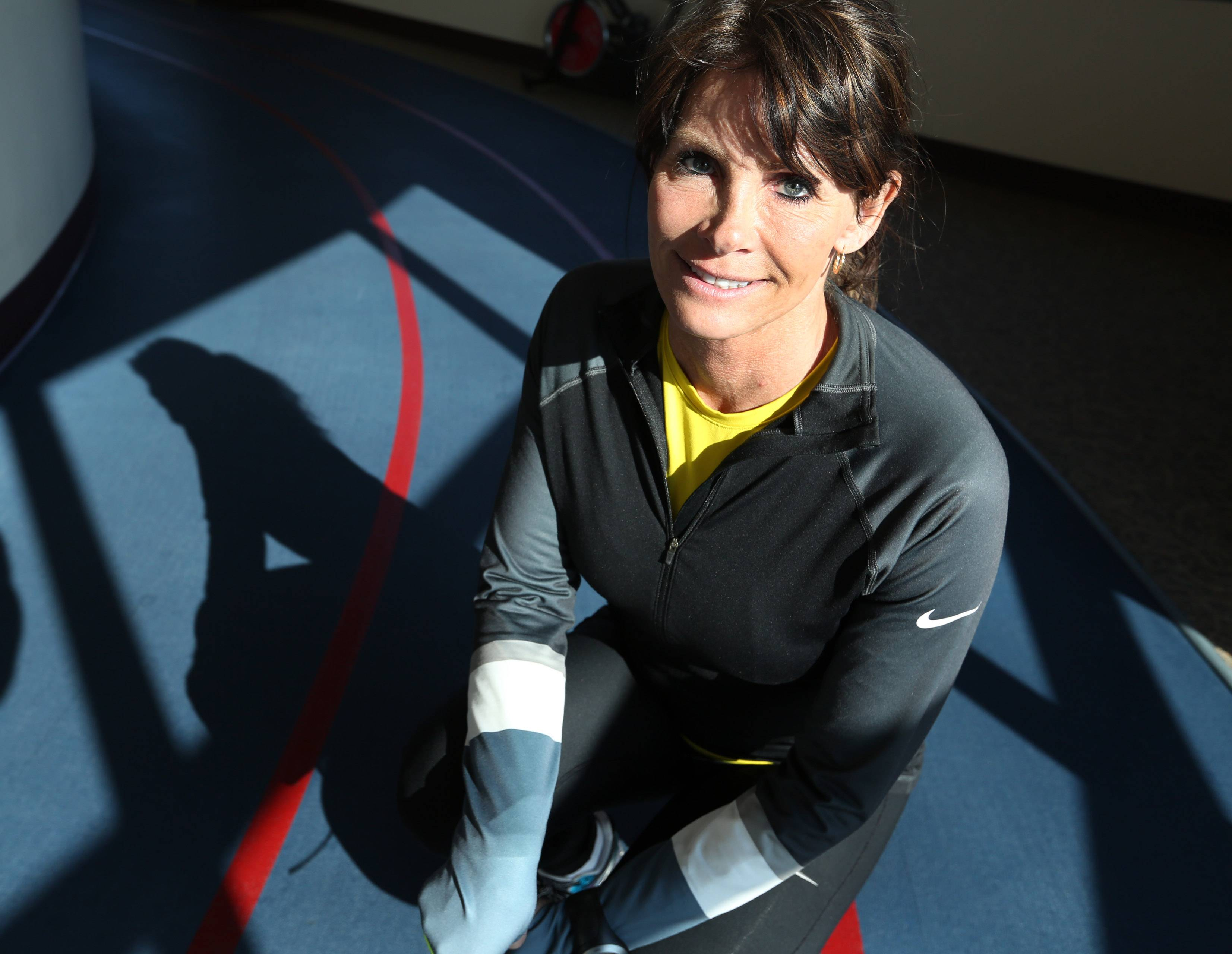 "Sue Balthazor, of Gurnee, was crossing the finish line of last year's Boston Marathon as one of the bombs exploded and will run the marathon again Monday. ""You have to show that you're strong enough to survive this,"" she said."