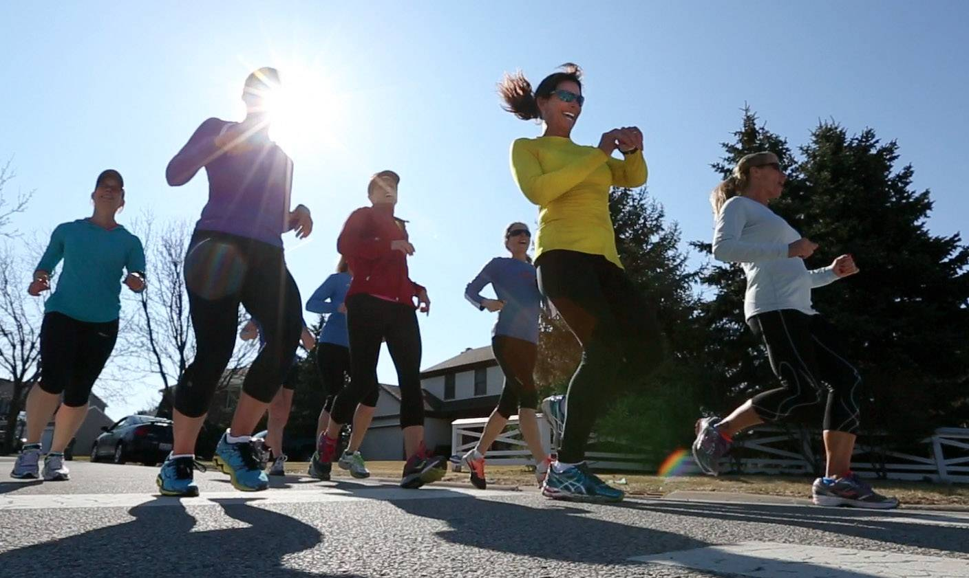Sue Balthazor of Gurnee, second from right, checks her time after running with the Jenny Spangler Running Club in Gurnee.