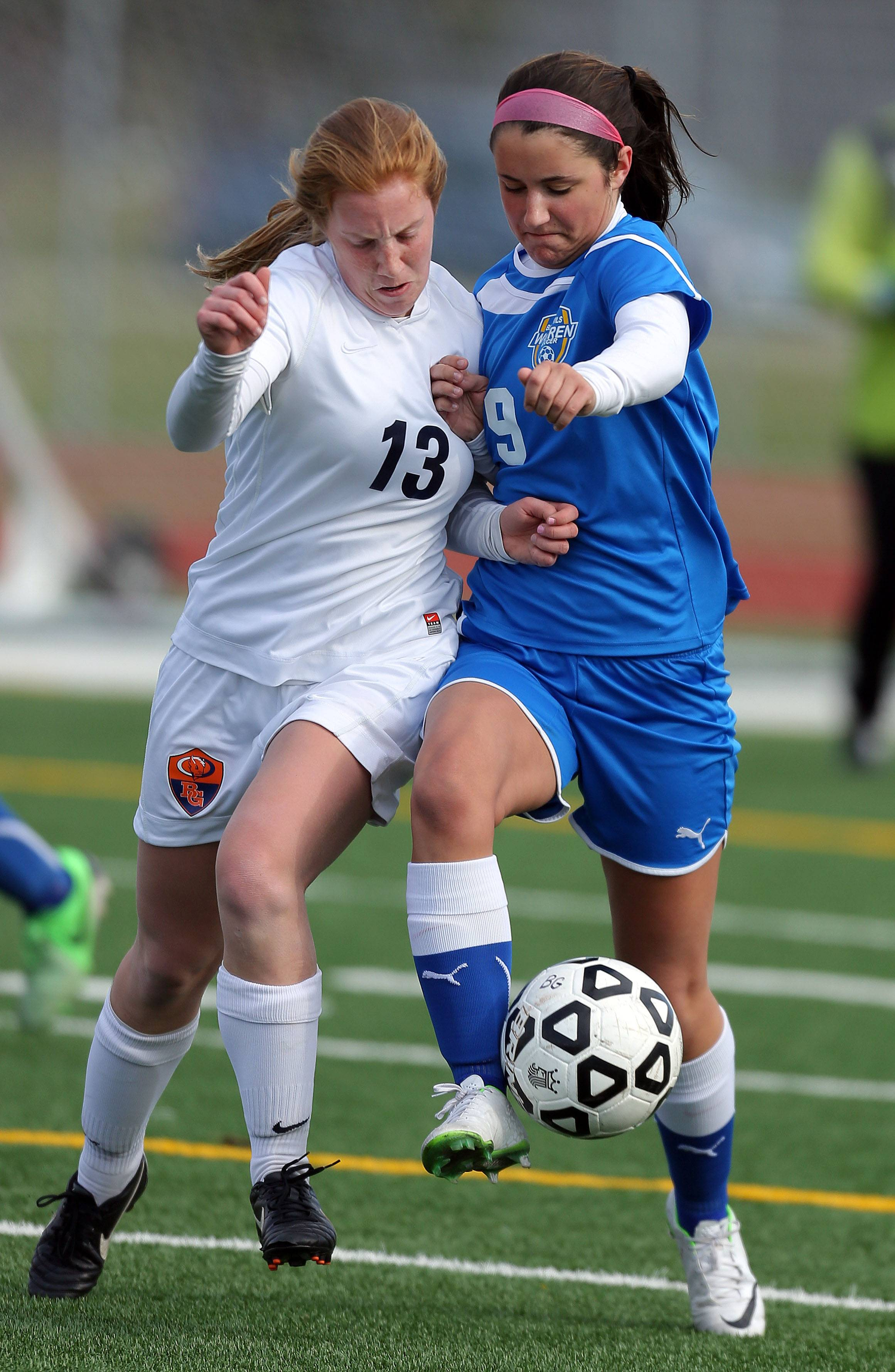 Buffalo Grove's Kelli Zickert, left and Warren's Haylee Parker fight for possession on Tuesday at Buffalo Grove.