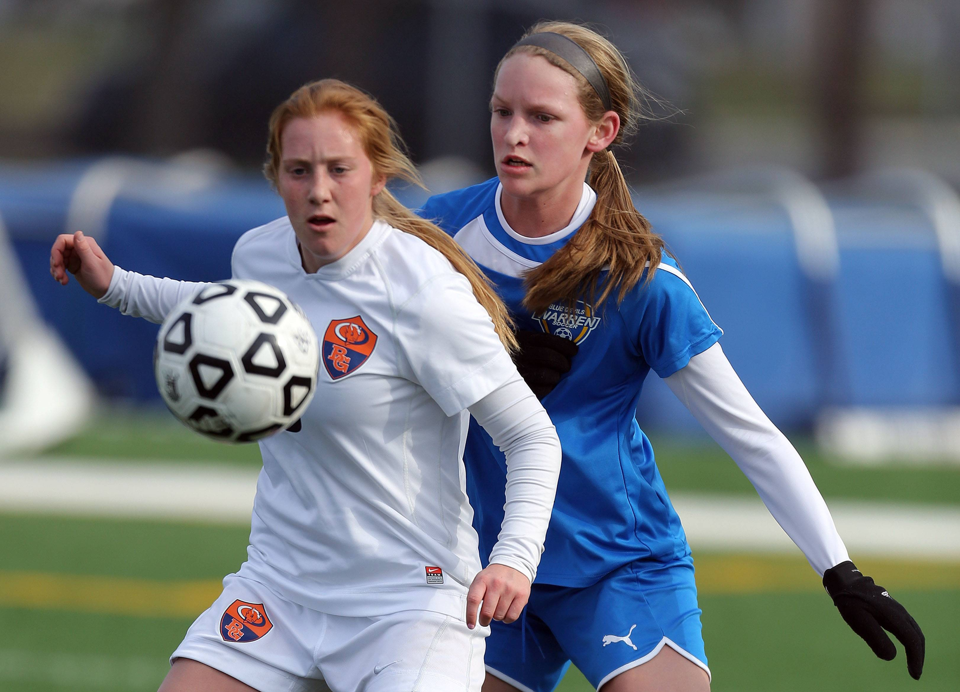 Buffalo Grove's Kelli Zickert, left and Warren's Natalee Slater battle for possession Tuesday at Buffalo Grove.