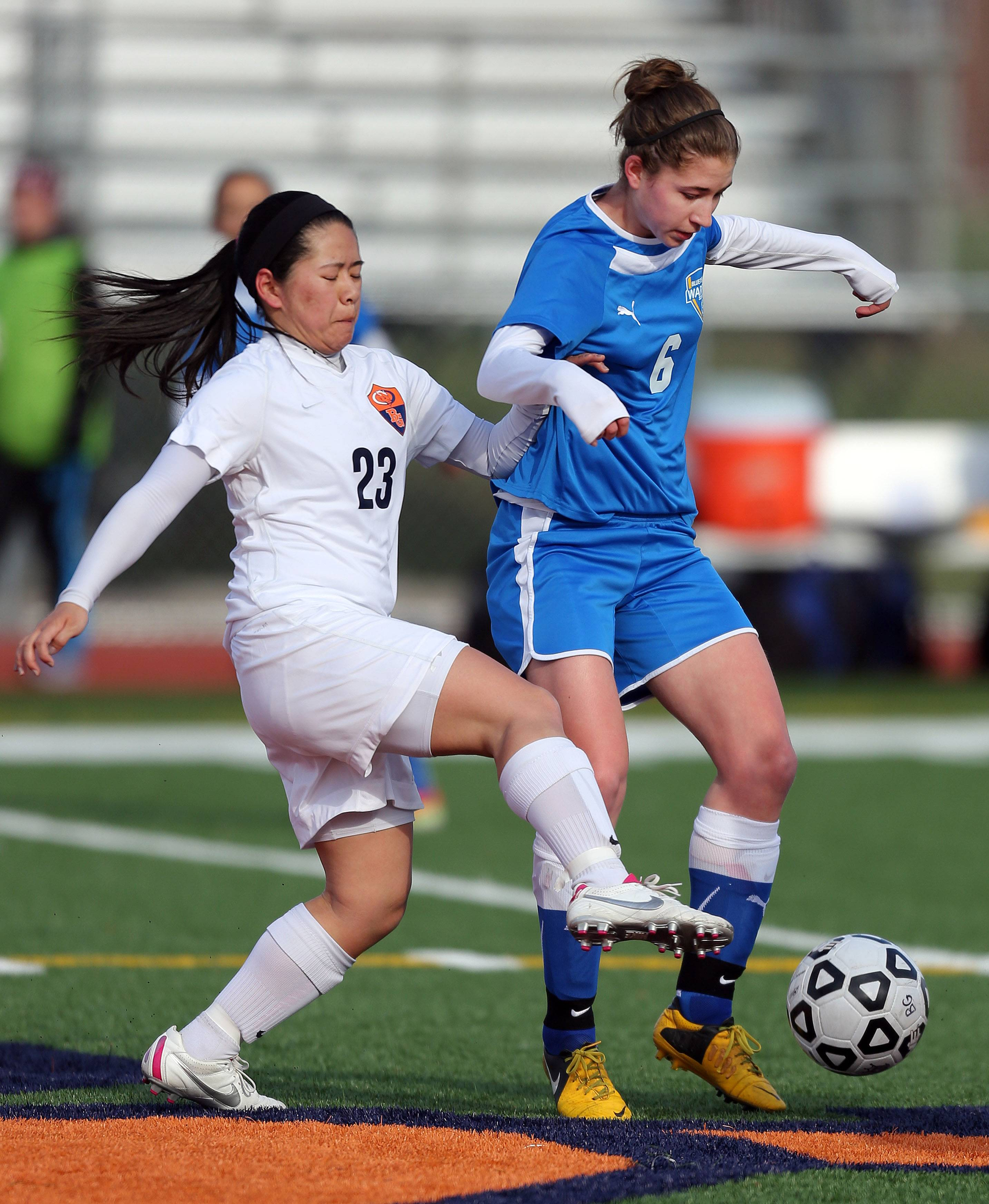 Buffalo Grove's Elizabeth Chan, left, and Warren's Emily Jahn battle for position Tuesday at Buffalo Grove.