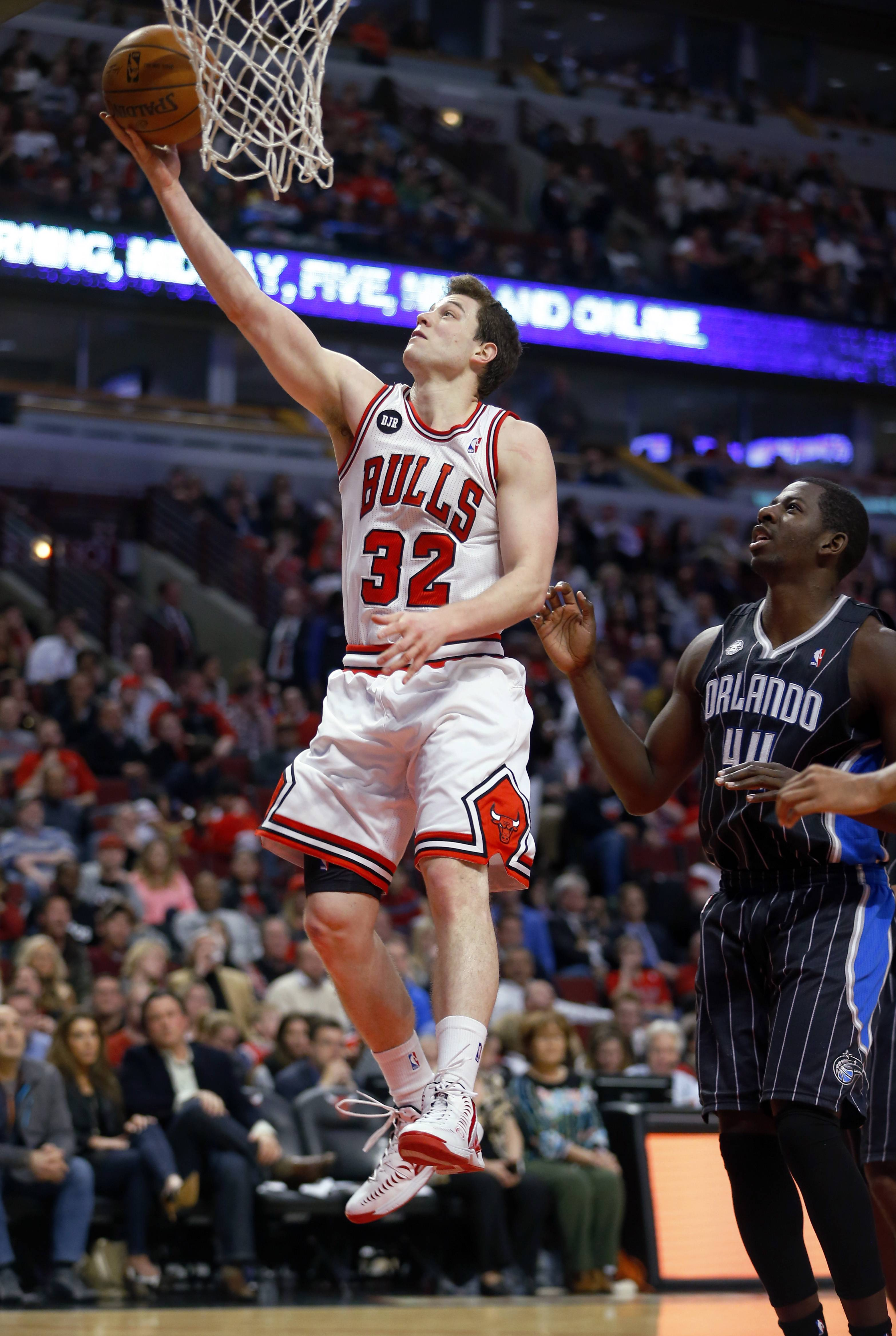 Chicago Bulls guard Jimmer Fredette (32) goes in for a lay-up past Orlando Magic forward Andrew Nicholson (44) during the second half of an NBA basketball game Monday in Chicago. The Bulls won the game 108-95.
