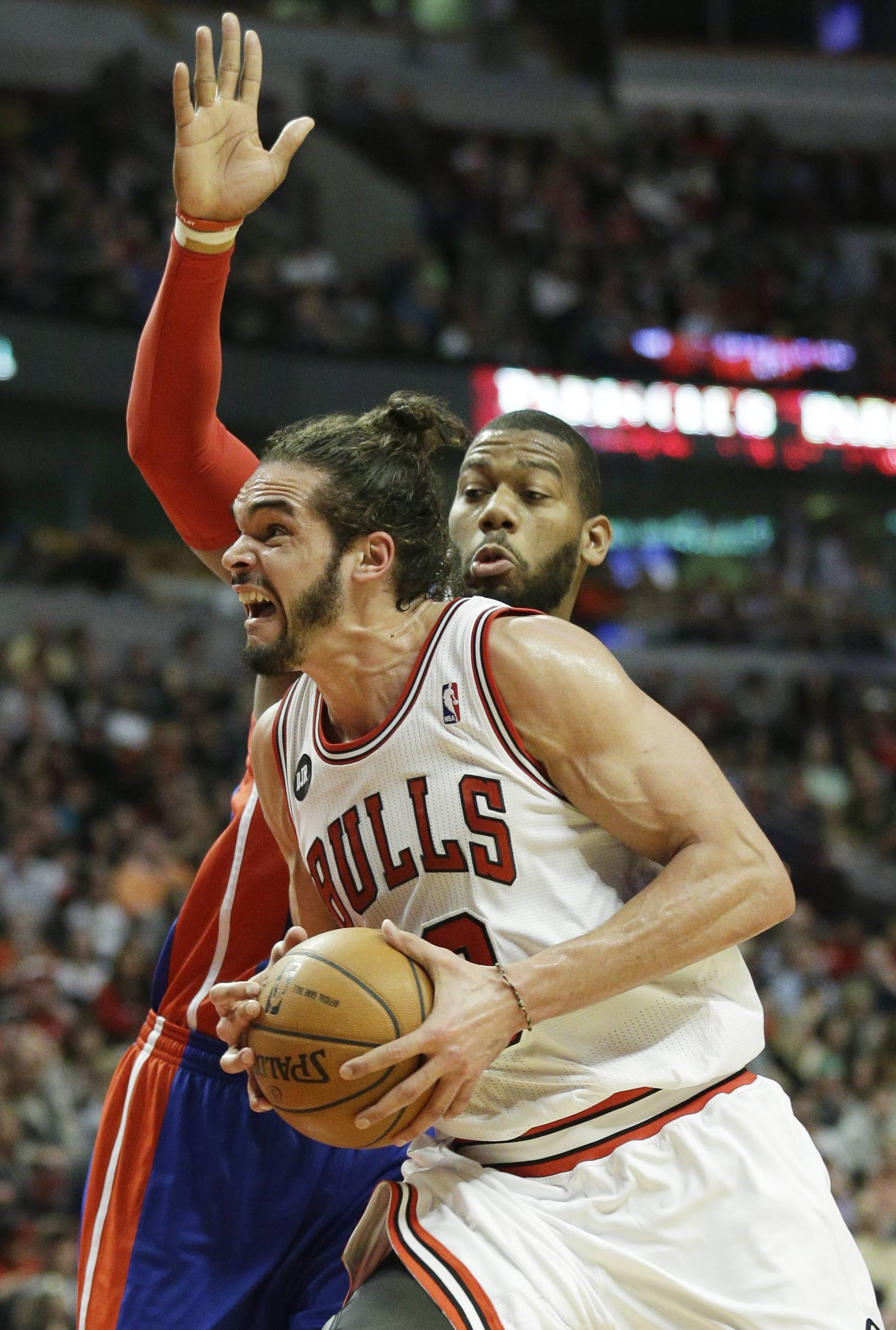 Chicago Bulls center Joakim Noah (13) drives against Detroit Pistons forward Greg Monroe (10) during the second half of an NBA basketball game in Chicago on Friday. The Bulls won 106-98.