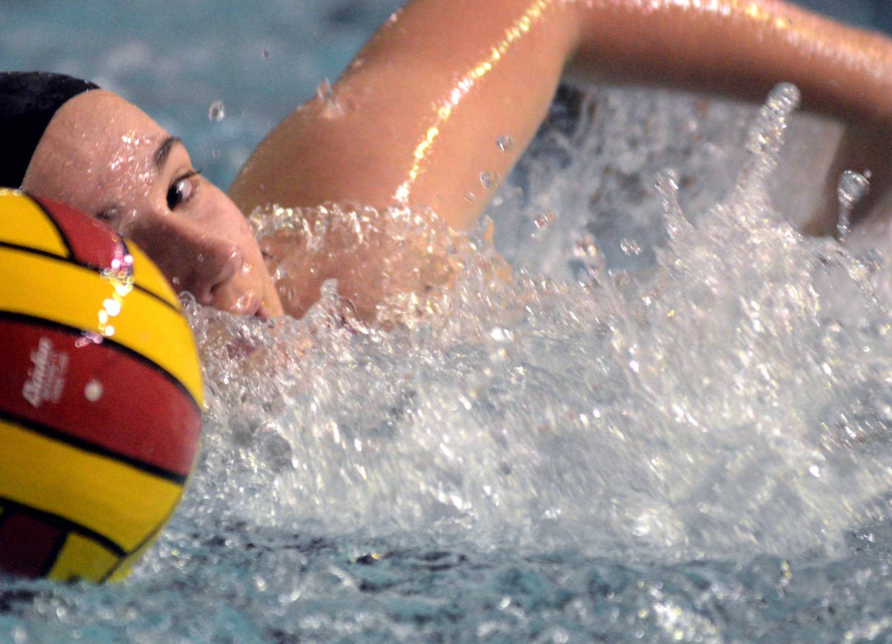Palatine's Caitlin McHugh moves the ball against Conant during Monday's water polo match in Palatine.
