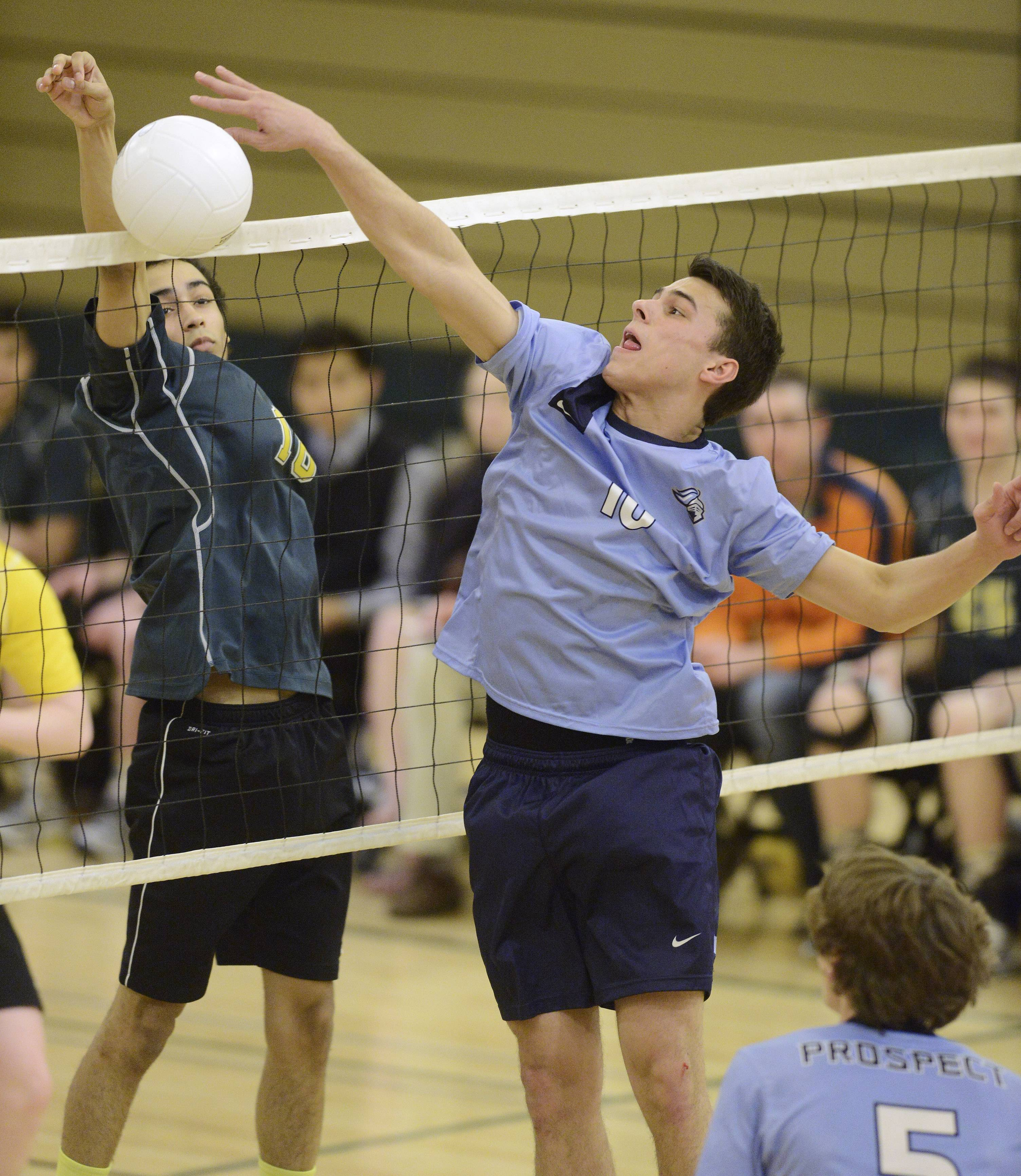 Prospect's Jacob Schwister, right, tries to tap the ball over the net in front of Elk Grove's Justin Jimenez Tuesday.