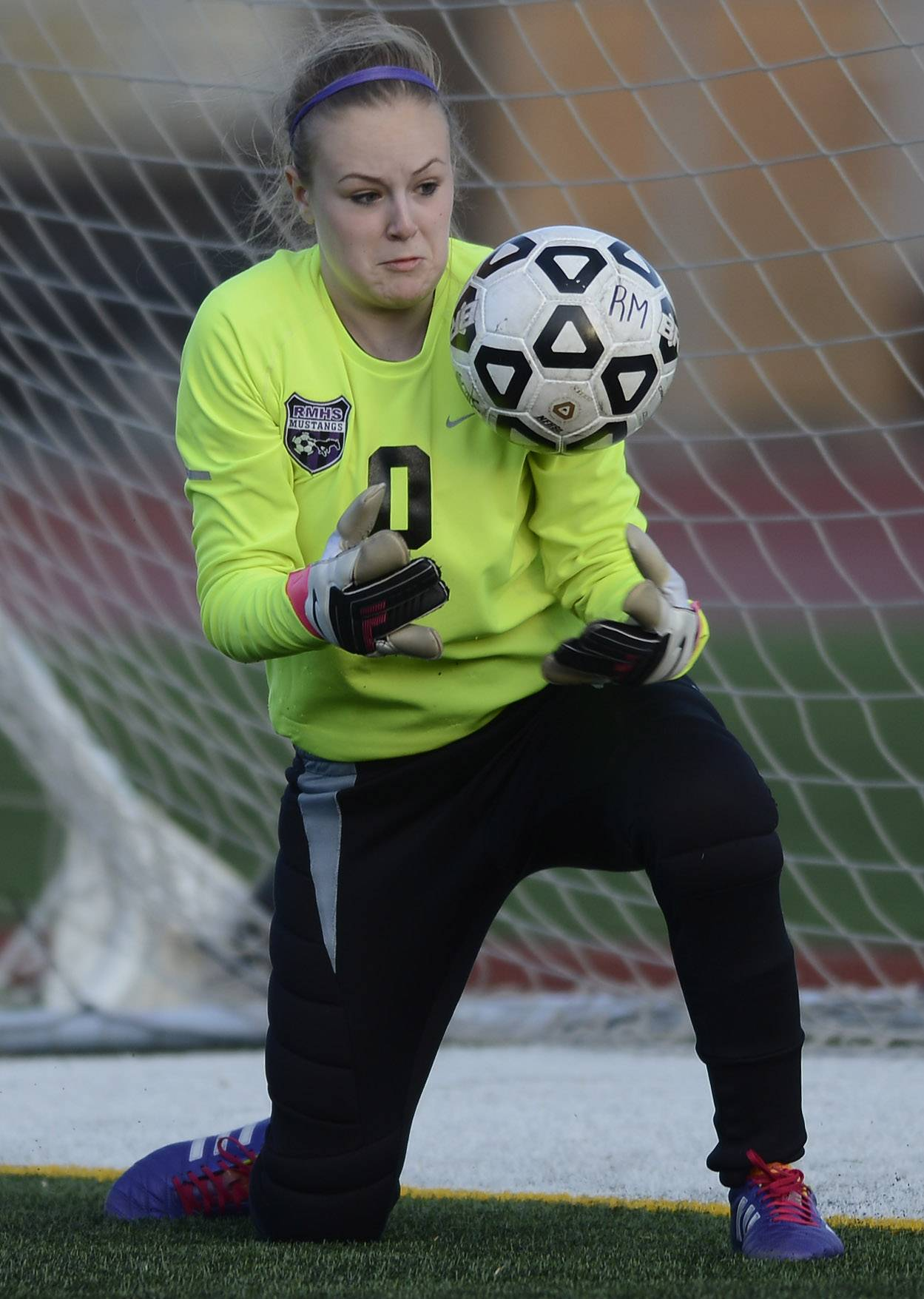 Rolling Meadows goal keeper Kelsey Nallon makes a save during Wednesday's home game against Fremd.