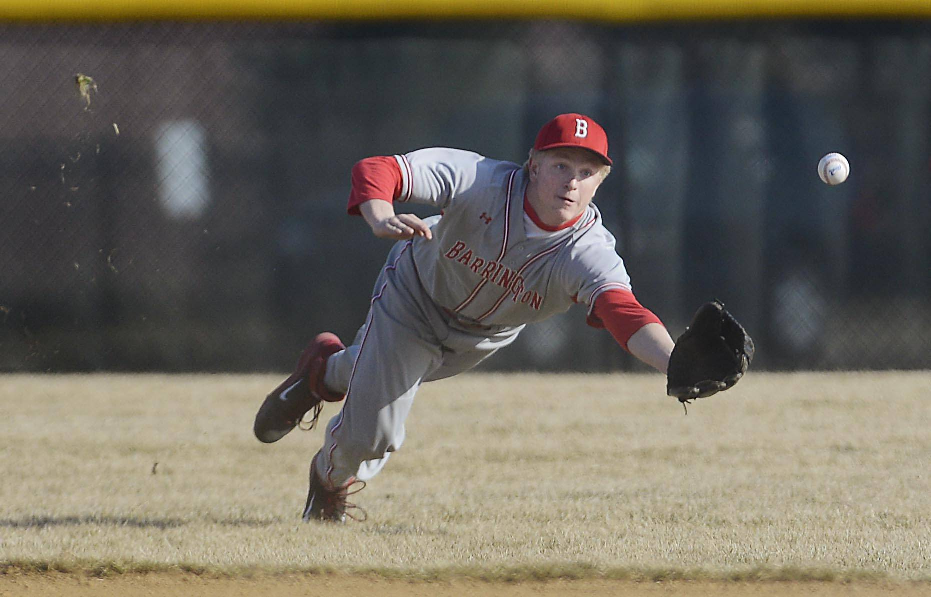 Barrington outfielder Mitch Pfeiffer dives but misses the ball on a  hit by Jacobs' Matt Kolzlak Wednesday in Algonquin.
