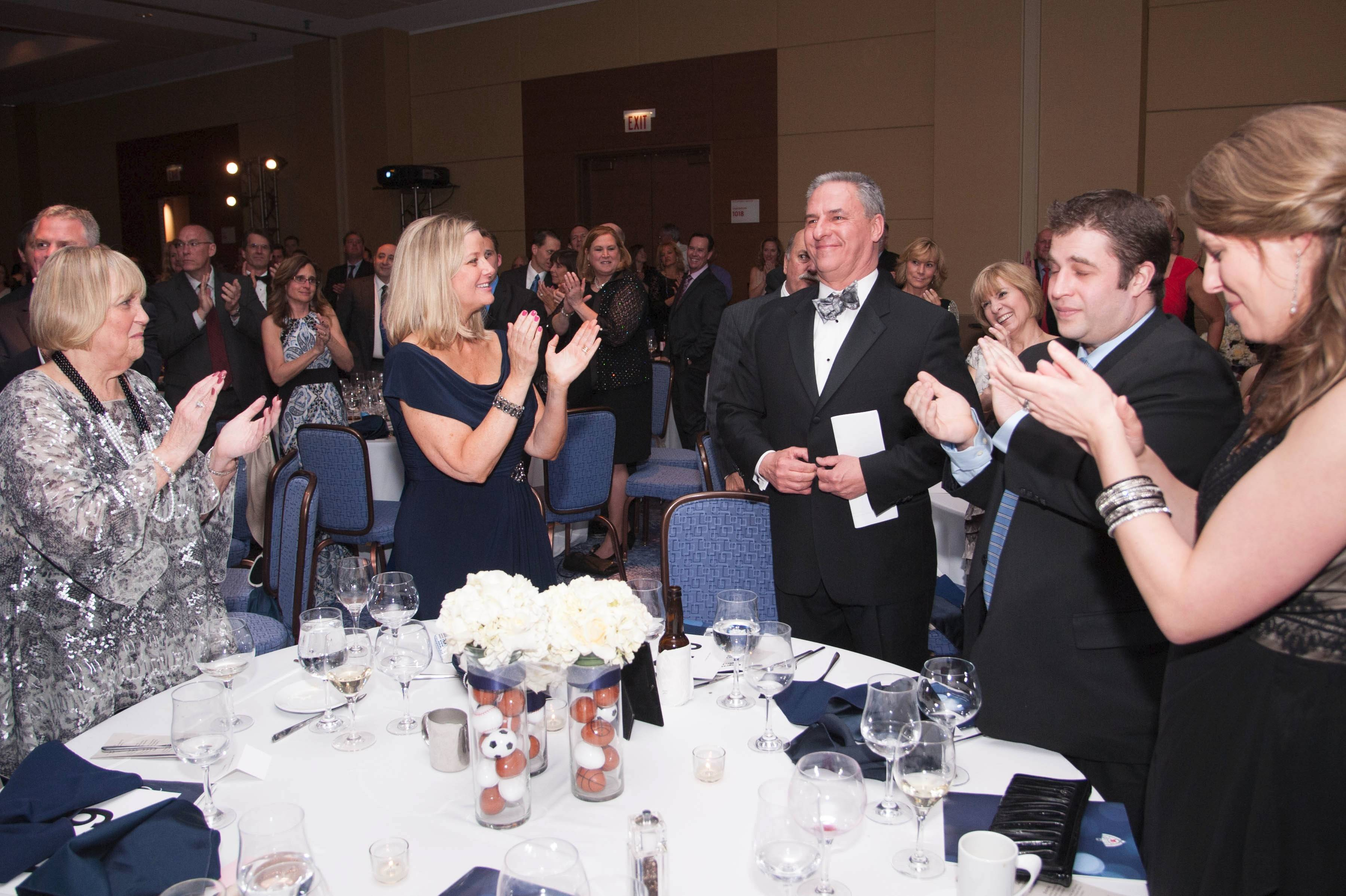 Jim Bristol is applauded by his family at Saint Viator High School's annual Night of the Lion Gala. Bristol was the night's honoree.