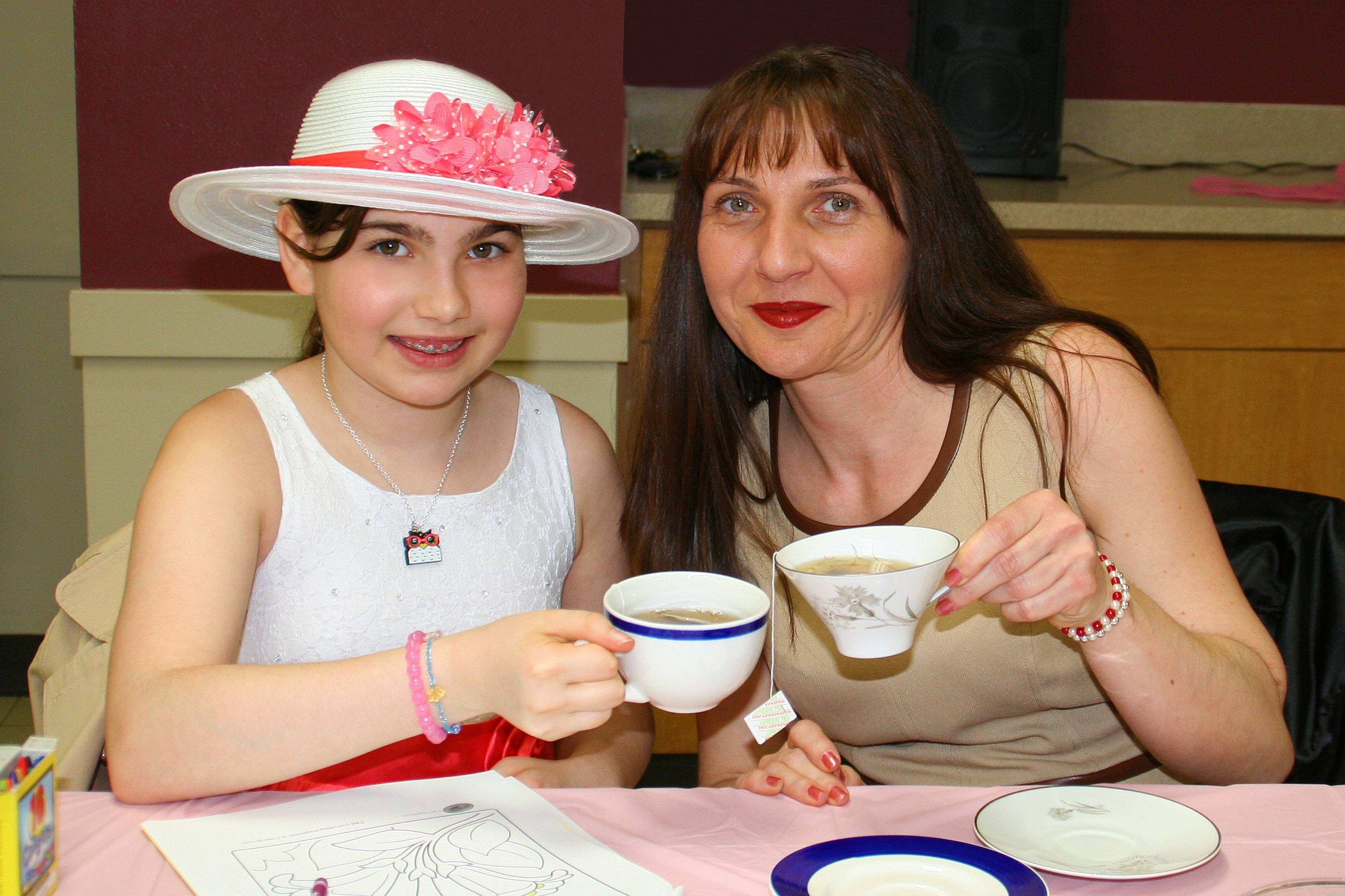Julia Krecu, 11, and her mom share a cup of tea at the annual Tea for Two on April 12 at Prairie Lakes Community Center.Lisa Haring