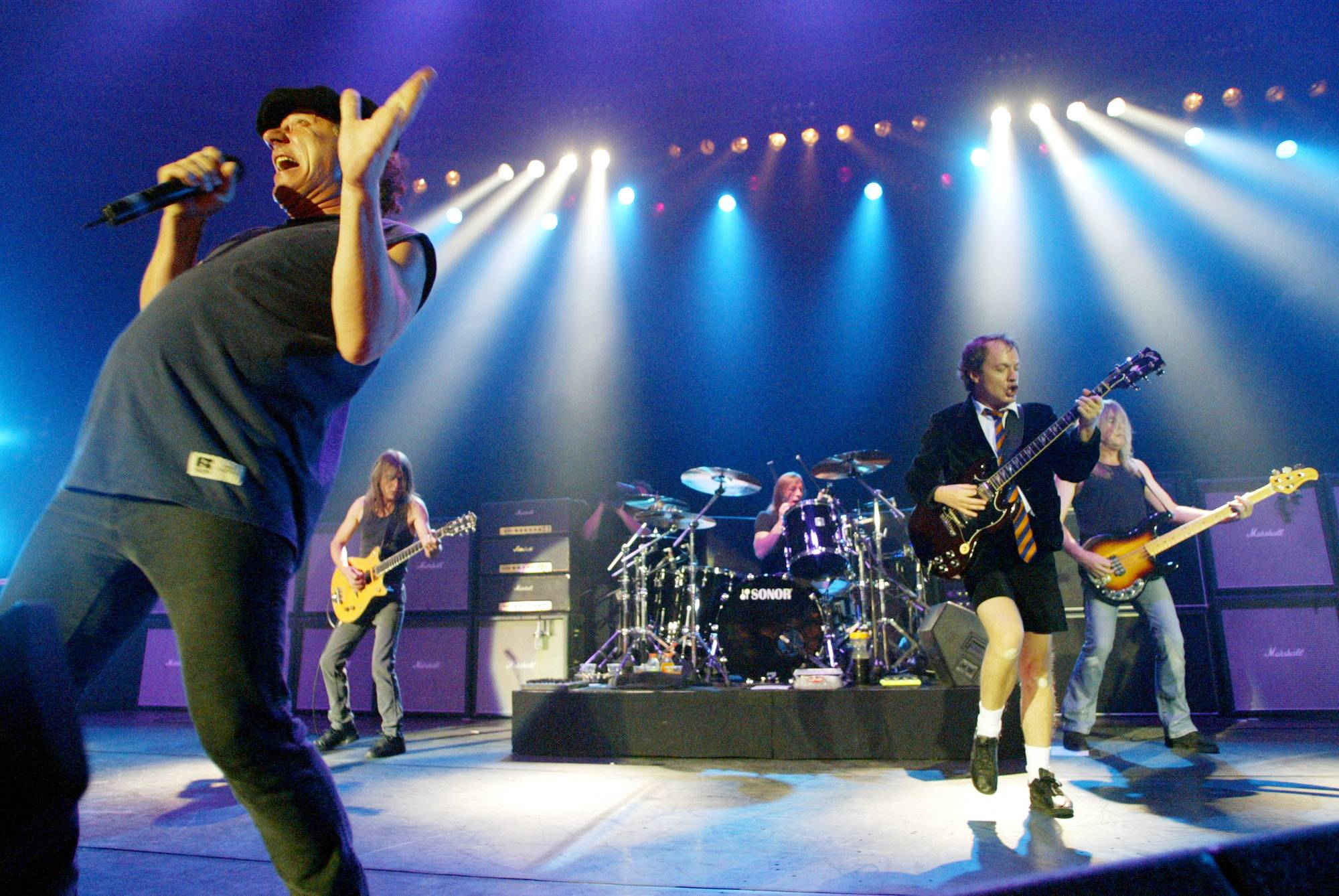"This June 17, 2003 file photo shows British rock band AC/DC, from left, Brian Johnson, Malcolm Young, Phil Rudd, Angus Young, and Cliff Williams performing on stage during a concert in Munich, southern Germany. Malcolm Young of AC/DC is taking a break from the band to focus on his health. The band posted on its Facebook page Wednesday that the 61-year-old guitarist is halting from the band ""due to ill health"" after 40 years."