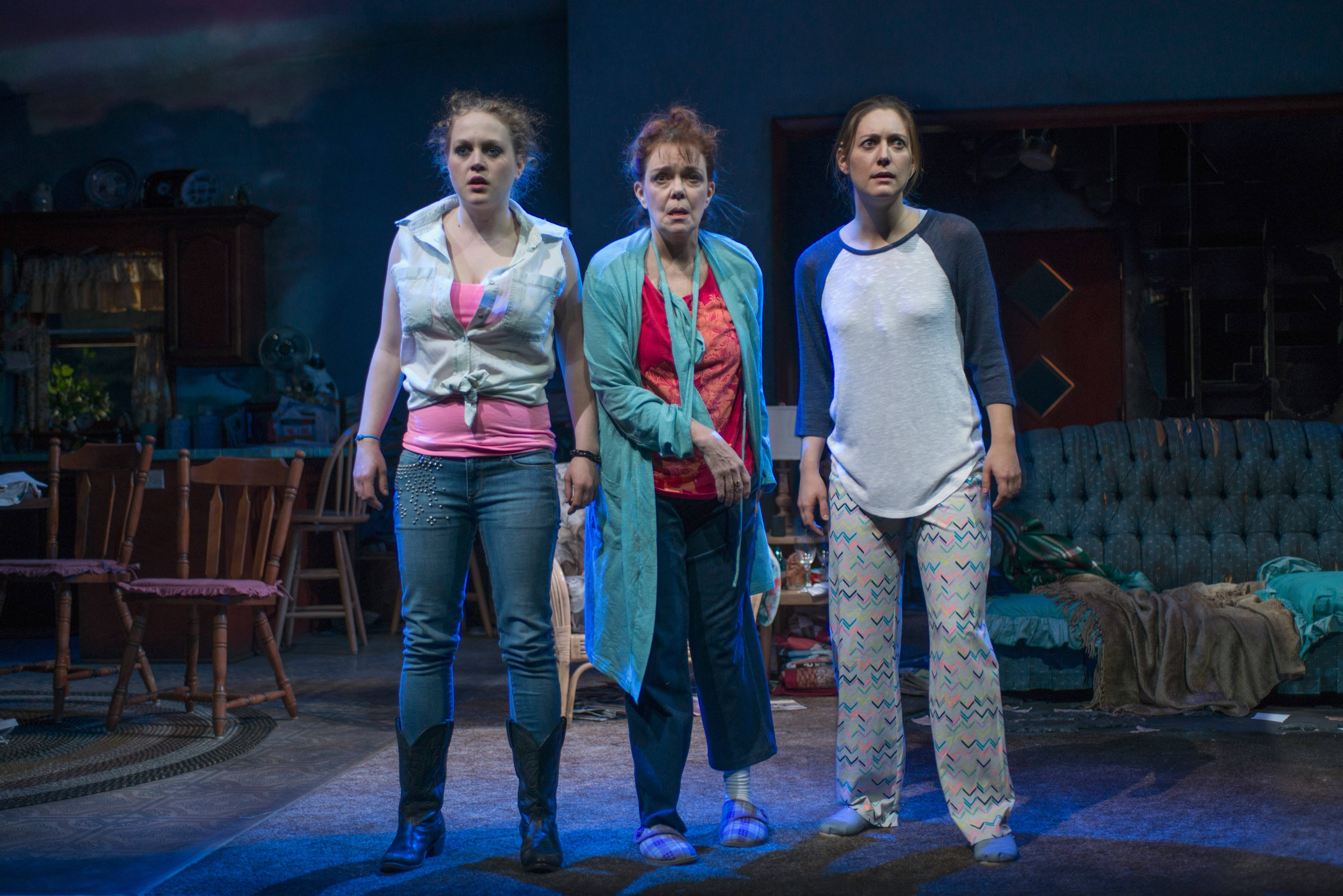 "Mom (Deirdre O'Connell), center, and her daughters Meesh (Caroline Neff), left, and Manda (Zoe Perry) face a dire future as their suburban life (literally) crumbles around them in Mona Mansour's ""The Way West"" in its world premiere at Steppenwolf Theatre."
