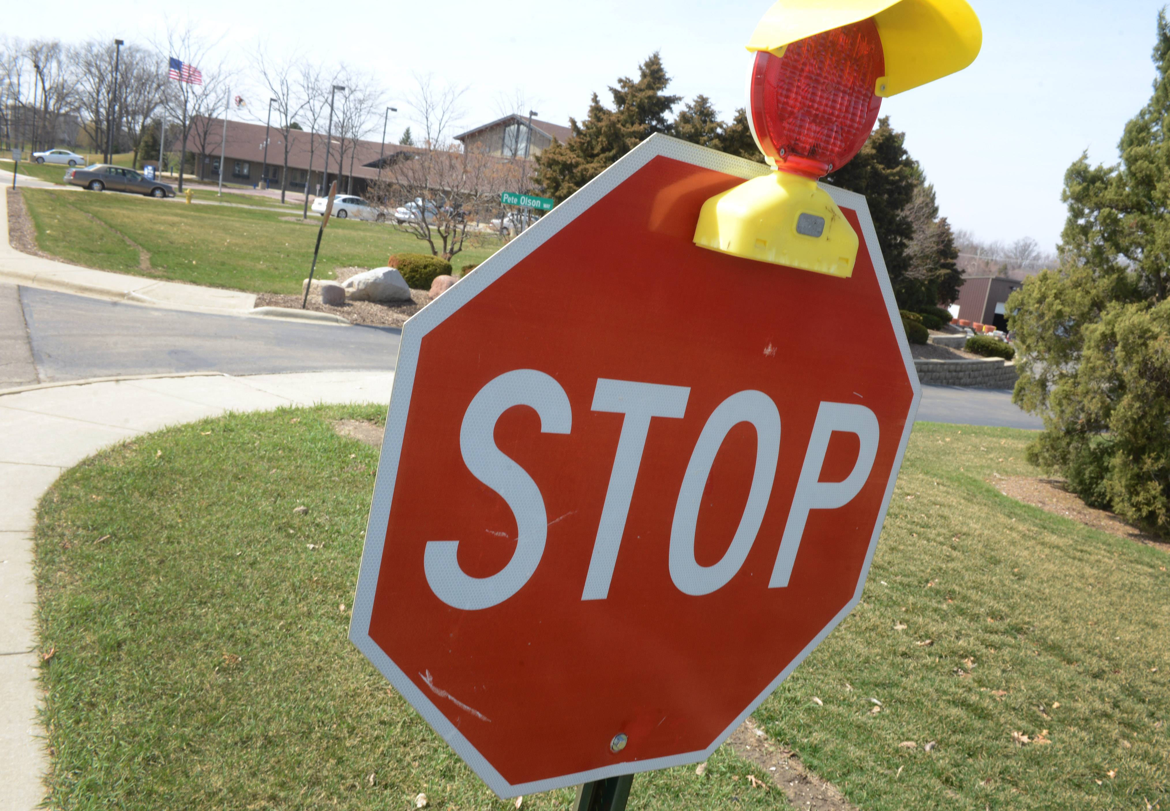 This stop sign in the Warren Township complex just outside Gurnee has a light to warn drivers at night. Township officials this week voiced concern about pedestrian safety on the busy site, saying too many drivers are running stop signs.