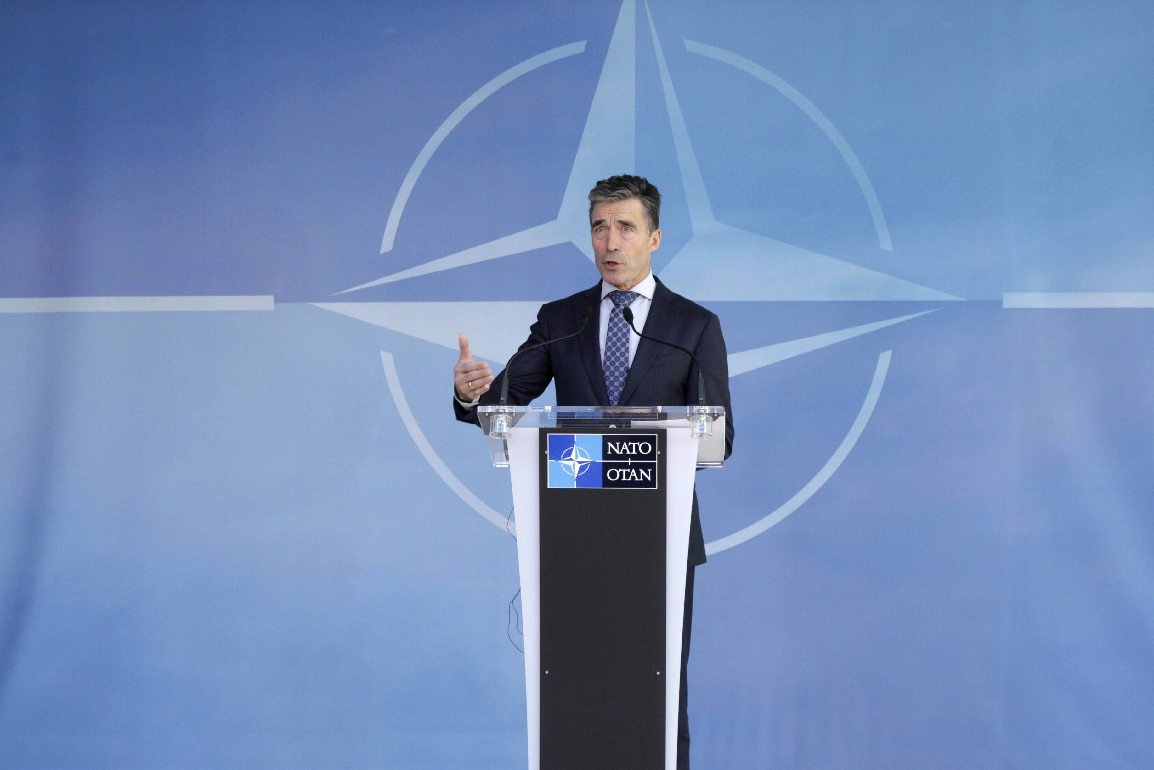 NATO Secretary General Anders Fogh Rasmussen addresses the media Wednesday after an NATO Ambassadors Council at NATO headquarters in Brussels. NATO says it's reinforcing its military presence on eastern border on sea, land and in the air.