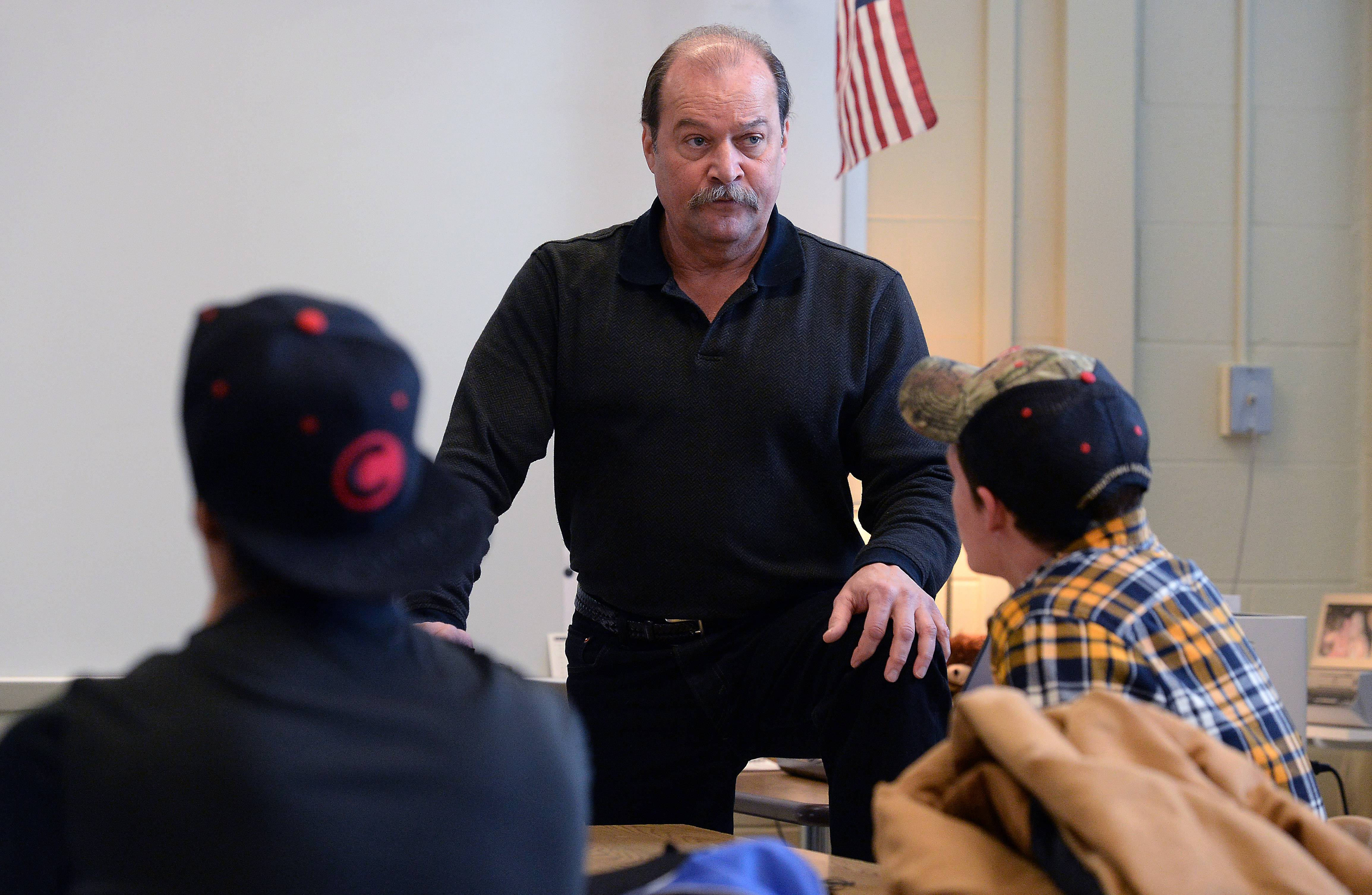 Bill Palmer addresses his students in his Resources in Interpersonal Communications class at Barrington High School. Palmer dropped out of Barrington High 46 years ago and uses his experience to help his students avoid making the same mistake he did.
