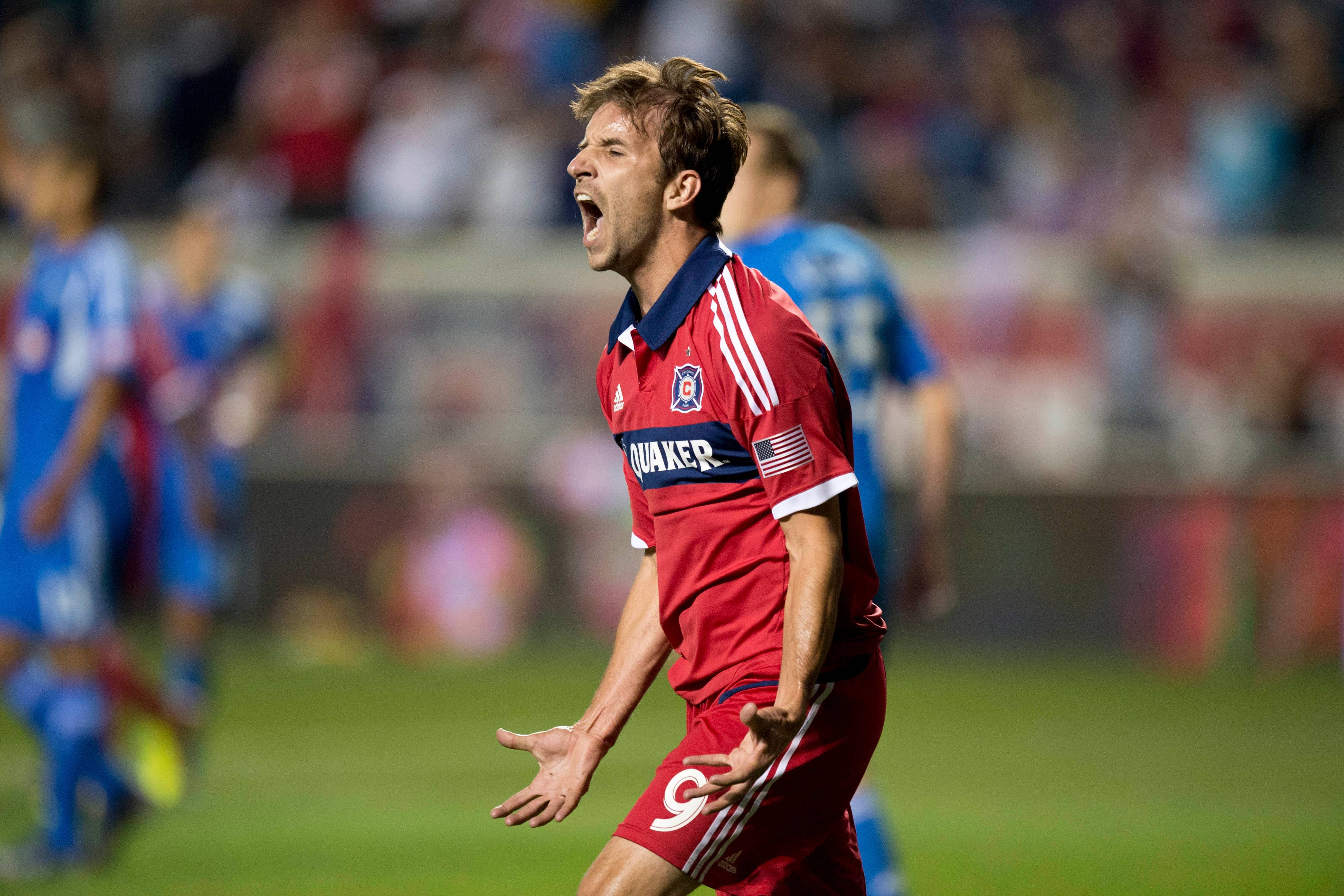 In this photo provided by the Chicago Fire, Chicago Fire forward Mike Magee celebrates his goal during the second half of an MLS soccer game against the Montreal Impact, Saturday, Sept. 28, 2013 in Bridgeview, Ill. The Fire and Impact tied 2-2. (AP Photo/Chicago Fire, Brian Kersey)