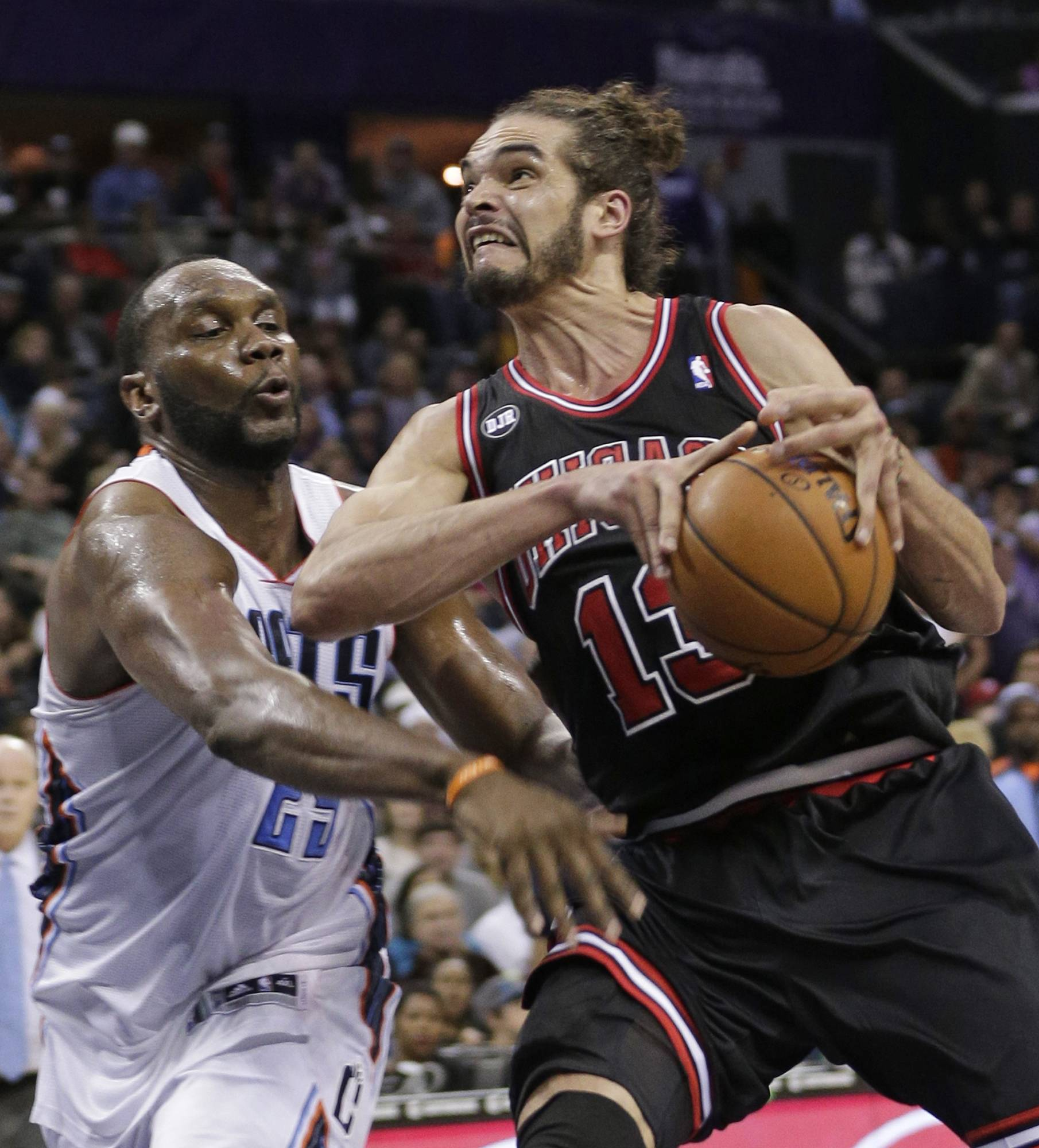 The Bobcats' Al Jefferson strips the ball from the Bulls' Joakim Noah during the second half of Wednesday night's regular-season finale. The Bulls finished 48-34 with the loss.