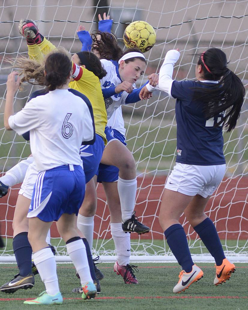 Rosary's Anna Sheen heads the ball away from the Royals' goal with West Aurora's Yulissa Espino ready to fight for it in the first half on Wednesday, April 16.