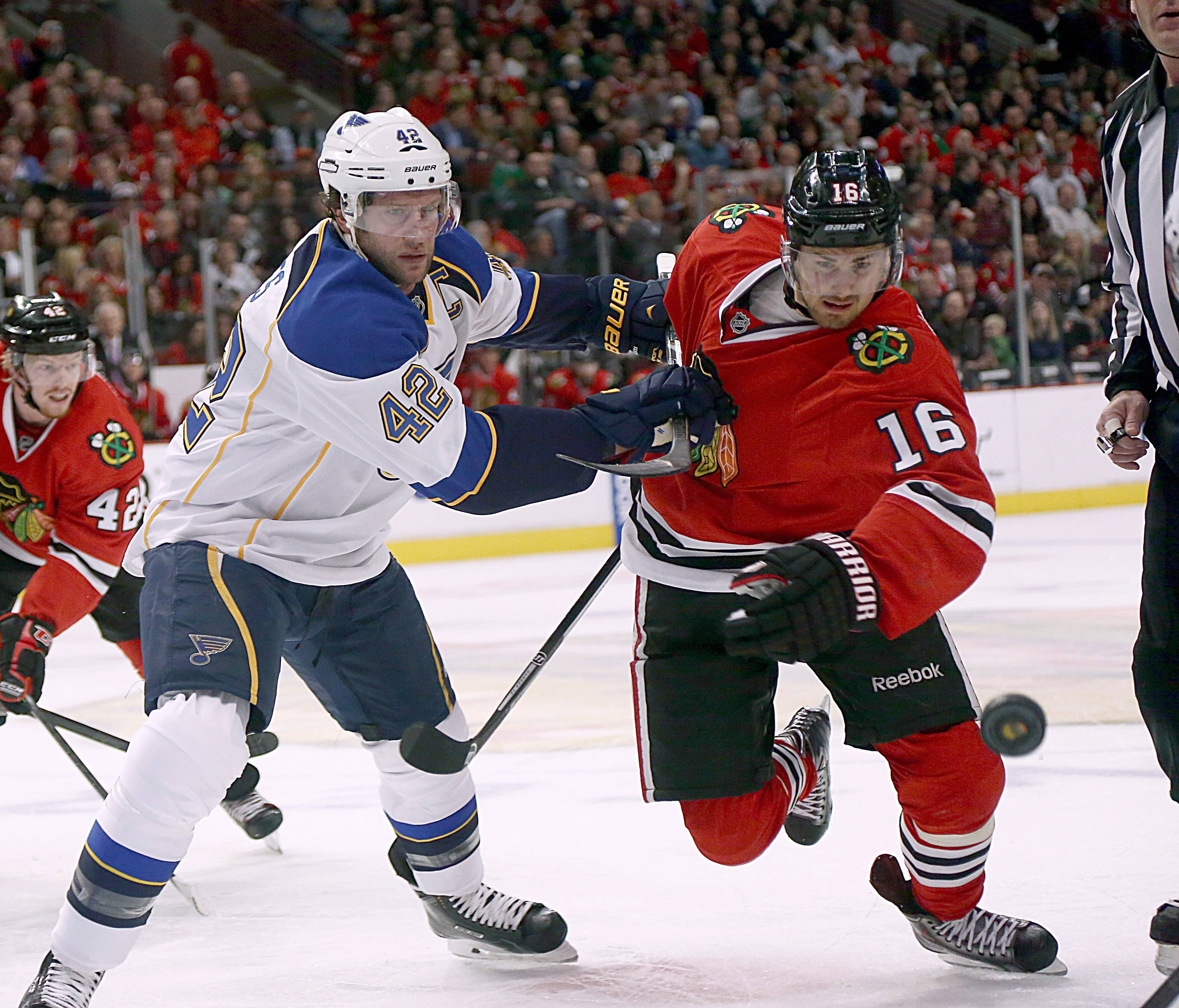 Tight battles for the pucks like this one between the Blackhawks' Marcus Kruger, right, and the Blues' David Backes start anew in Thursday night's series opener.