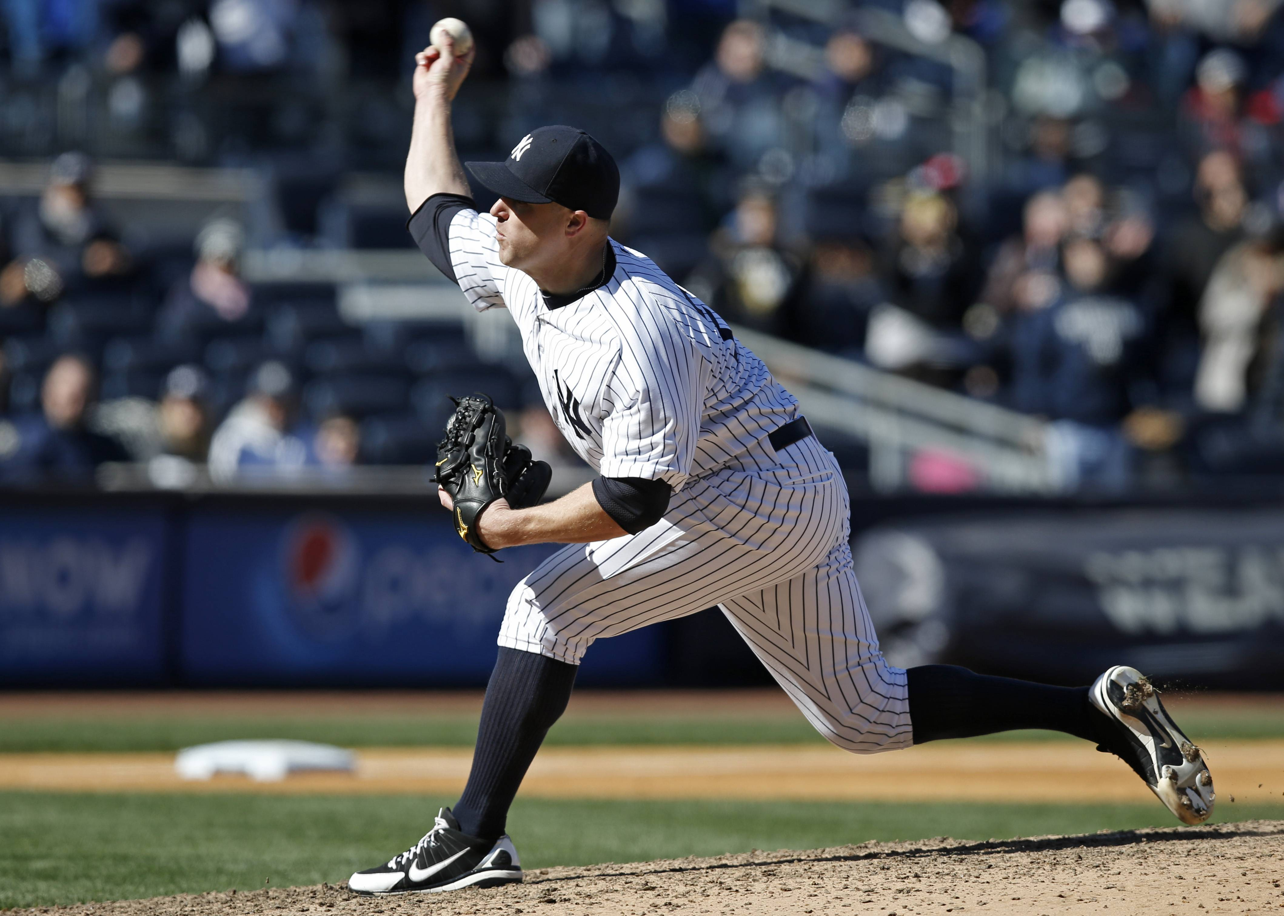 New York Yankees relief pitcher Shawn Kelley delivers in the ninth inning of the Yankees' 3-0 shutout of the Chicago Cubs in the first game of a day-night interleague baseball doubleheader at Yankee Stadium in New York, Wednesday, April 16, 2014. (AP Photo/Kathy Willens)