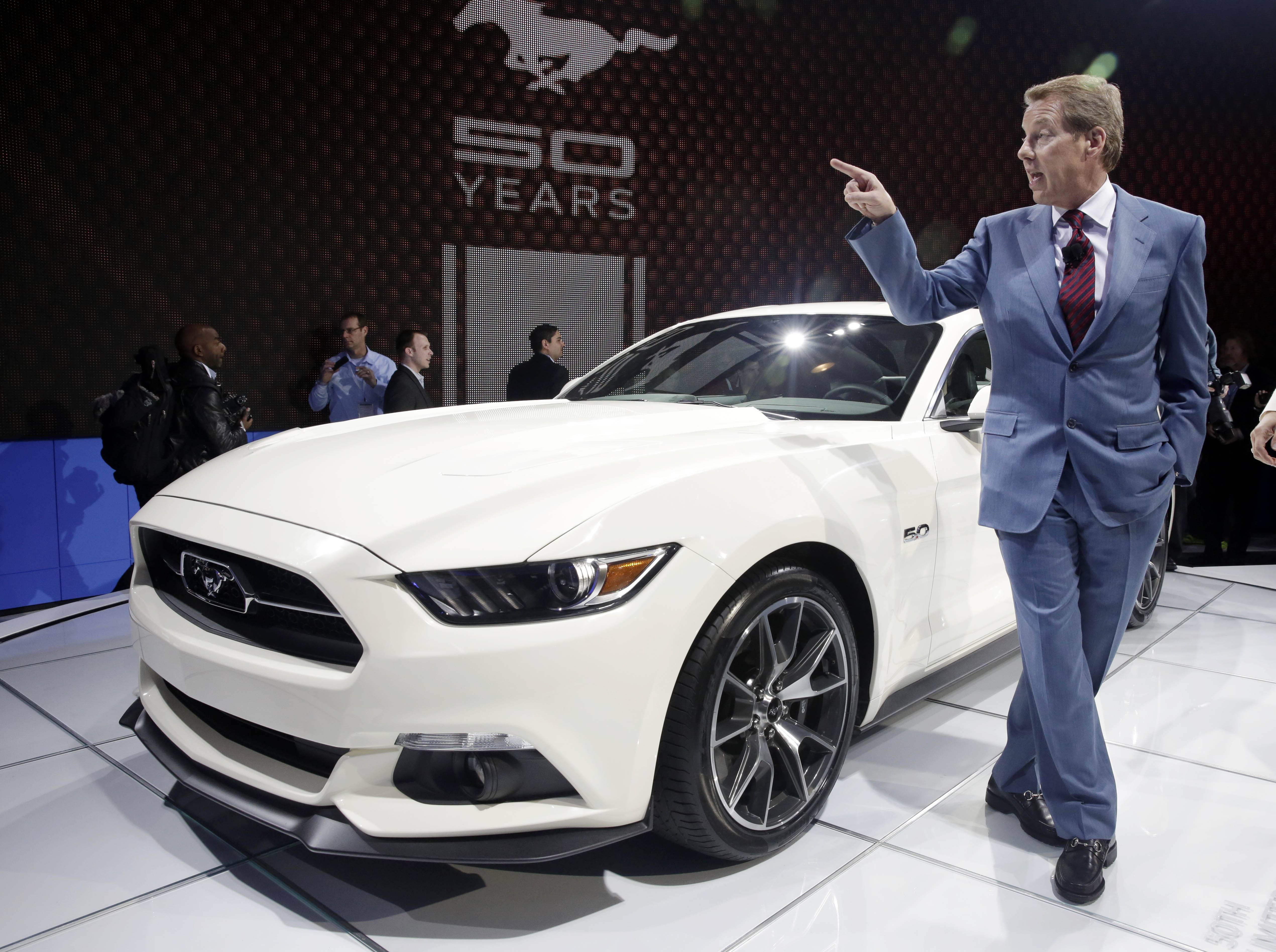 "Ford Motor Company CEO and President Bill Ford introduces the 2015 Ford Mustang 50 Year Limited Edition at the 2014 New York International Auto Show. ""If you don't like this car, you don't like cars,"" said Ford, whose first car was an electric green 1975 Mustang."