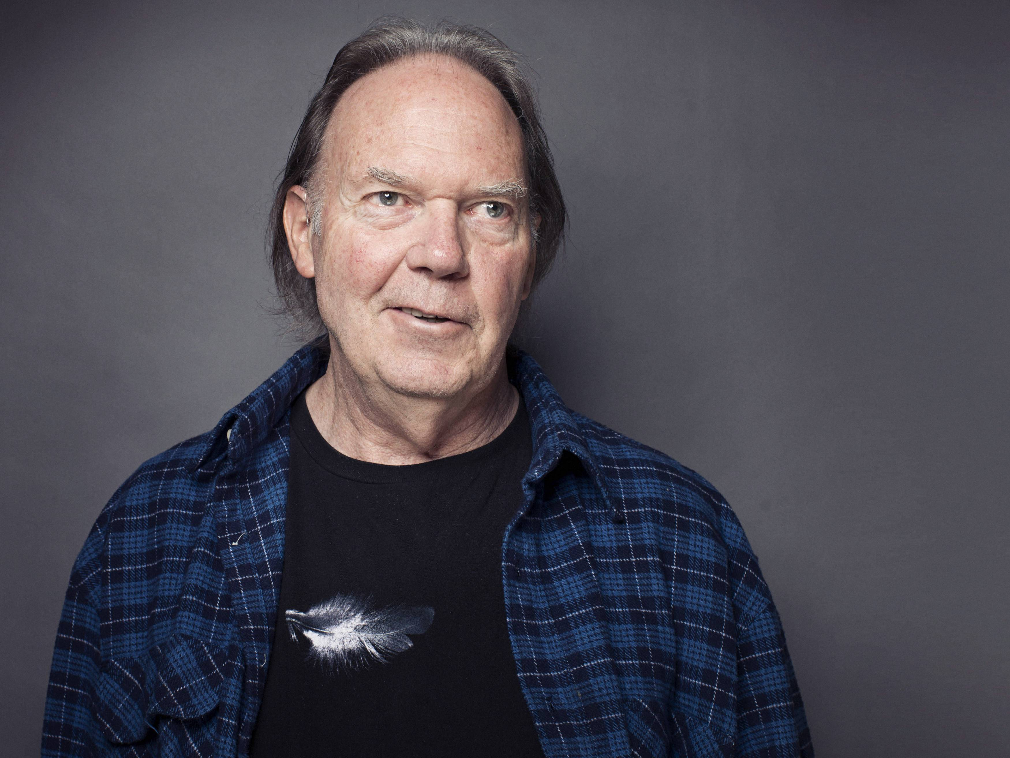This 2012 file photo shows singer-songwriter Neil Young posing for a portrait at The Carlyle hotel in New York. Young has raised more than $6 million through a Kickstarter campaign to fund his digital music project PonoMusic. Kickstarter closed the campaign Tuesday after raising 6.2 million through 18,000 supporters. The campaign is the third most funded project for Kickstarter.