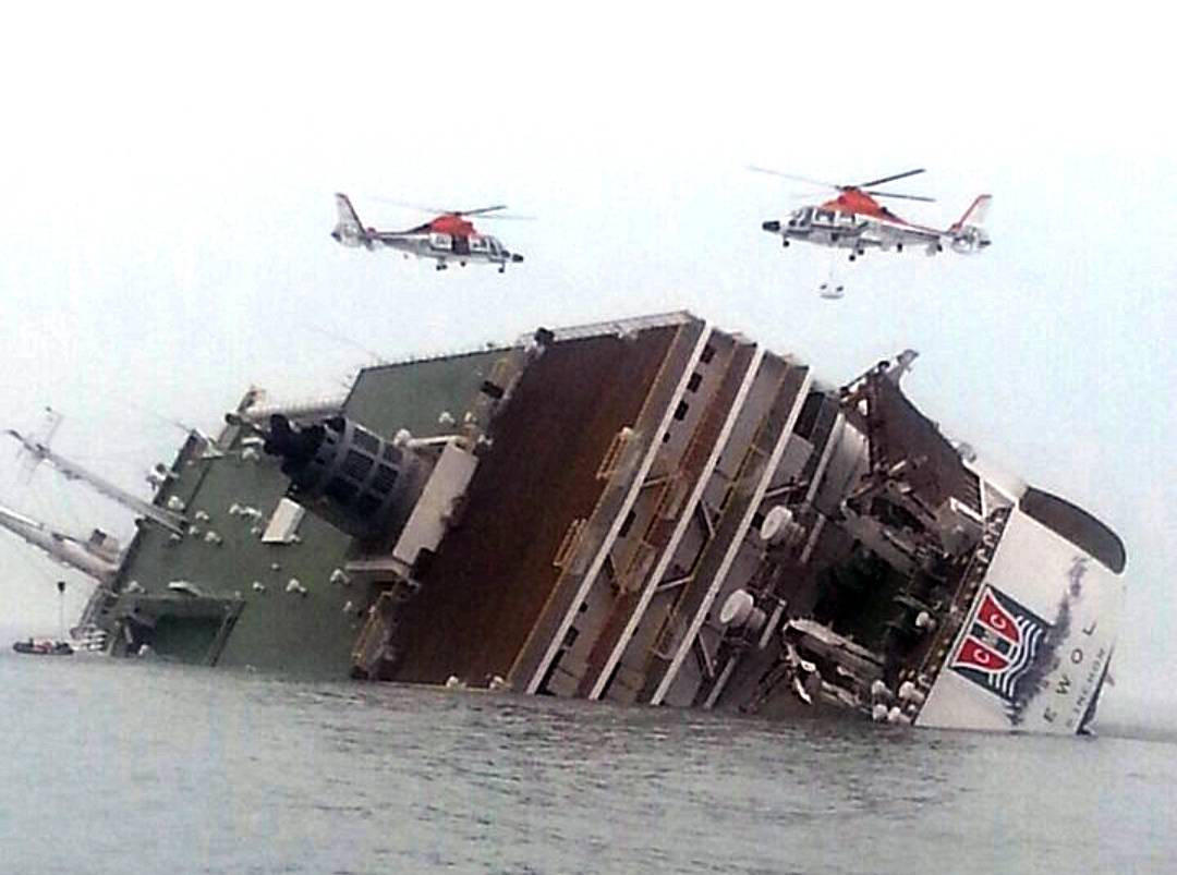Rescue helicopters fly over a sinking South Korean passenger ferry that was carrying more than 450 passengers, mostly high school students, Wednesday, April 16, 2014, off South Korea's southern coast. Hundreds of people are missing despite a frantic, hourslong rescue by dozens of ships and helicopters. At least four people were confirmed dead and 55 injured.