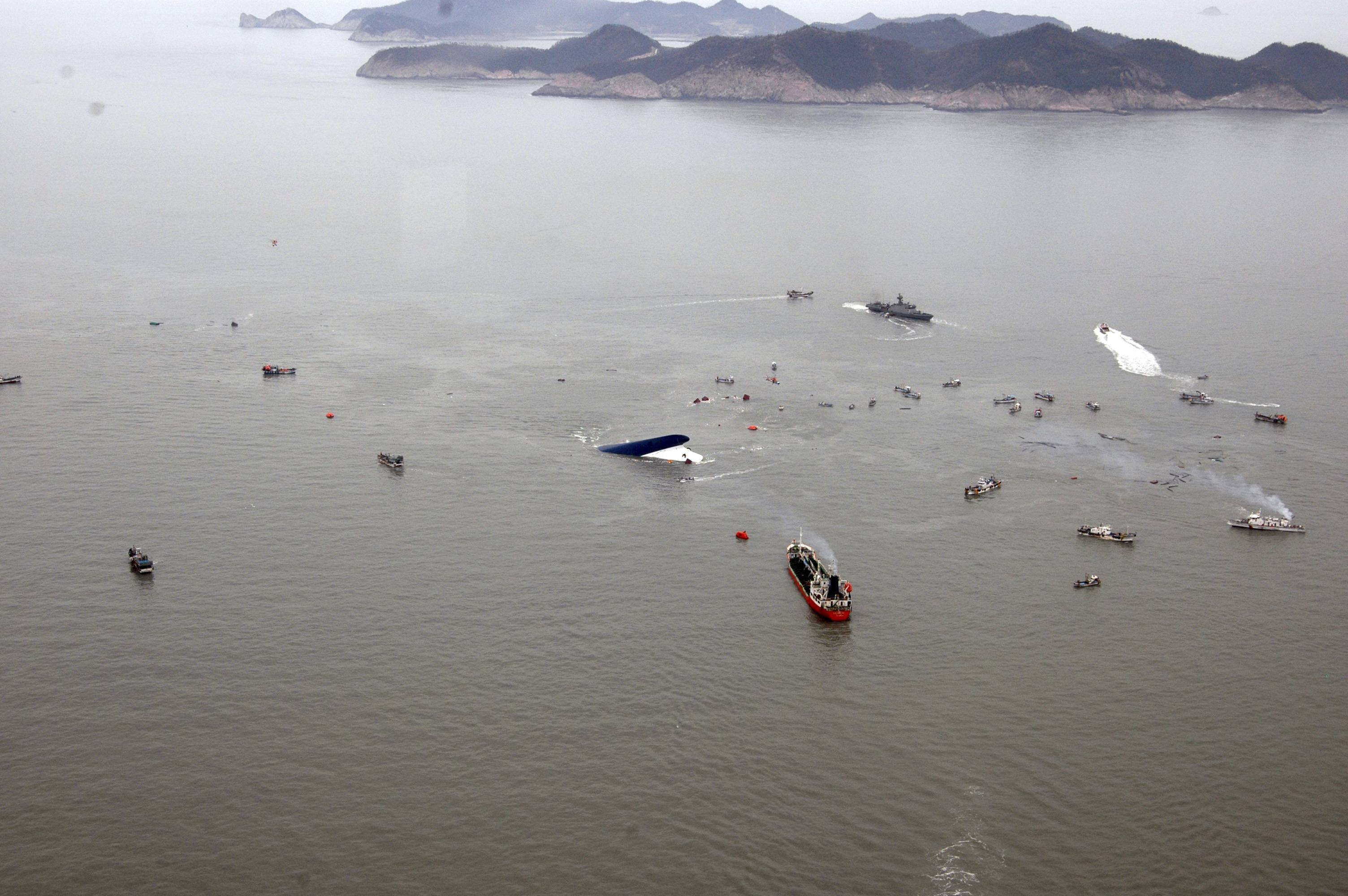 In this photo released by South Korean Navy via Yonhap News Agency, South Korean rescue team boats and fishing boats try to rescue passengers of a ferry sinking off South Korea's southern coast, in the water off the southern coast near Jindo, south of Seoul, Wednesday, April 16, 2014. Nearly 300 people were still missing Wednesday several hours after a ferry carrying 477, most of them high school students, sank in cold waters off South Korea's southern coast.