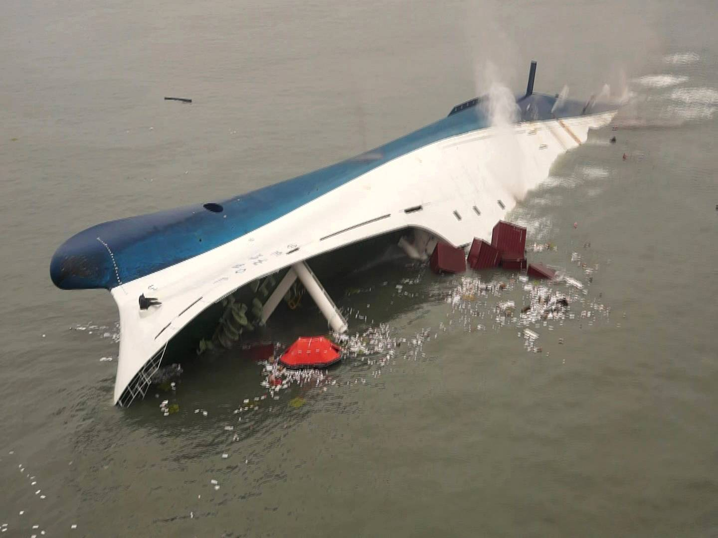 In this photo released by South Korea Coast Guard via Yonhap News Agency, a ferry sinks in the water off the southern coast near Jindo, south of Seoul, Wednesday, April 16, 2014. Nearly 300 people were still missing Wednesday several hours after a ferry carrying 459, most of them high school students, sank in cold waters off South Korea's southern coast, killing at least two and injuring seven, officials said.
