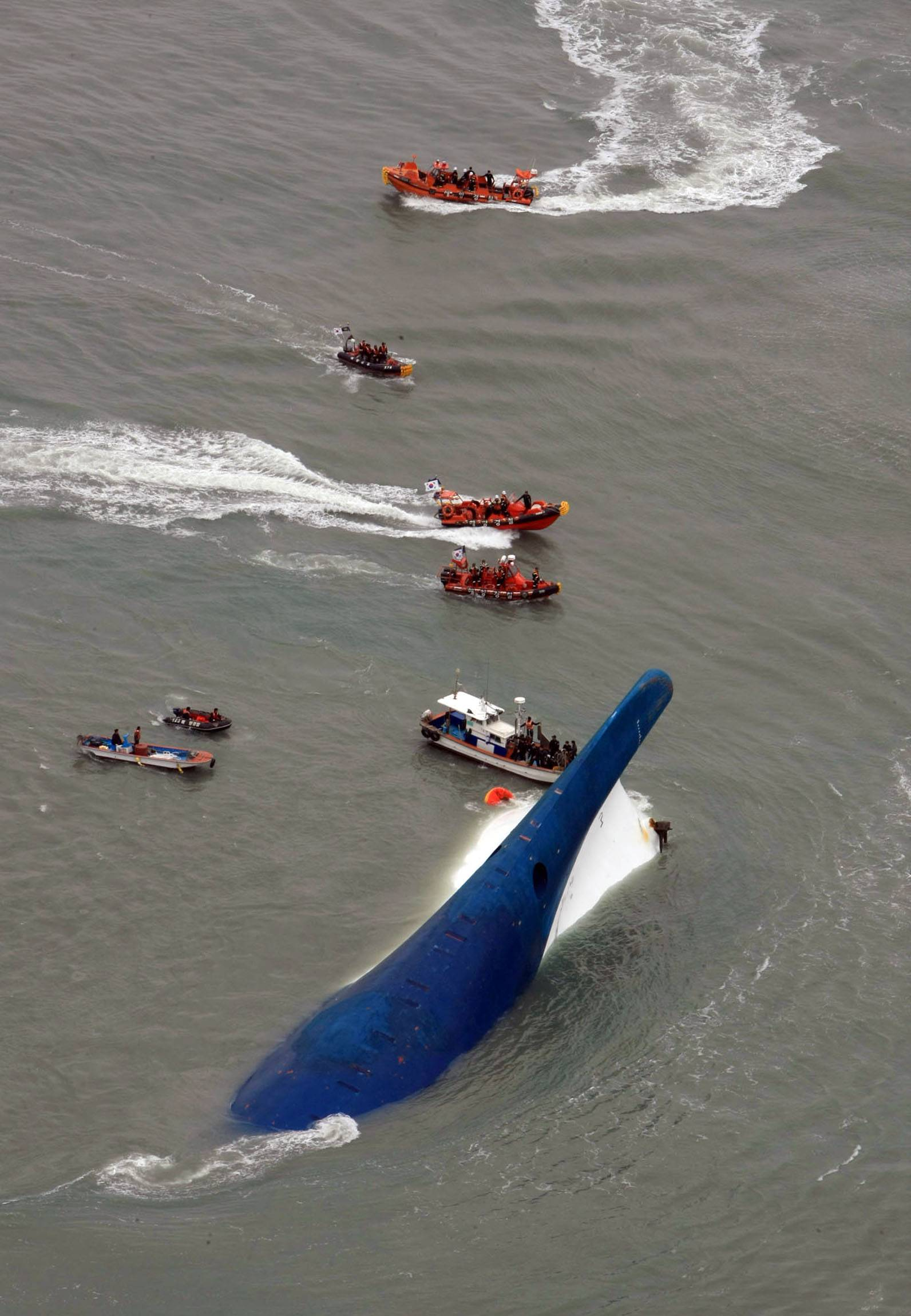 In this photo released by Jeollanamdo via Yonhap News Agency, South Korean rescue team boats and fishing boats try to rescue passengers of a ferry sinking off South Korea's southern coast, in the water off the southern coast near Jindo, south of Seoul, Wednesday, April 16, 2014. Nearly 300 people were still missing Wednesday several hours after a ferry carrying 477, most of them high school students, sank in cold waters off South Korea's southern coast.
