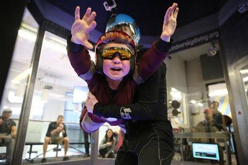 Wearing an Iron Man costume, Max Vertin, 7, from Hastings, Neb., floats in a wind tunnel simulating free fall, during a day hosted by the Make-A-Wish Foundation at SkyVenture Colorado in Lone Tree, Colo., south of Denver, on Tuesday April 15, 2014. Vertin suffers from Duchenne muscular dystrophy, a rare disease affecting him and his two brothers, causing their muscles to slowly deteriorate.