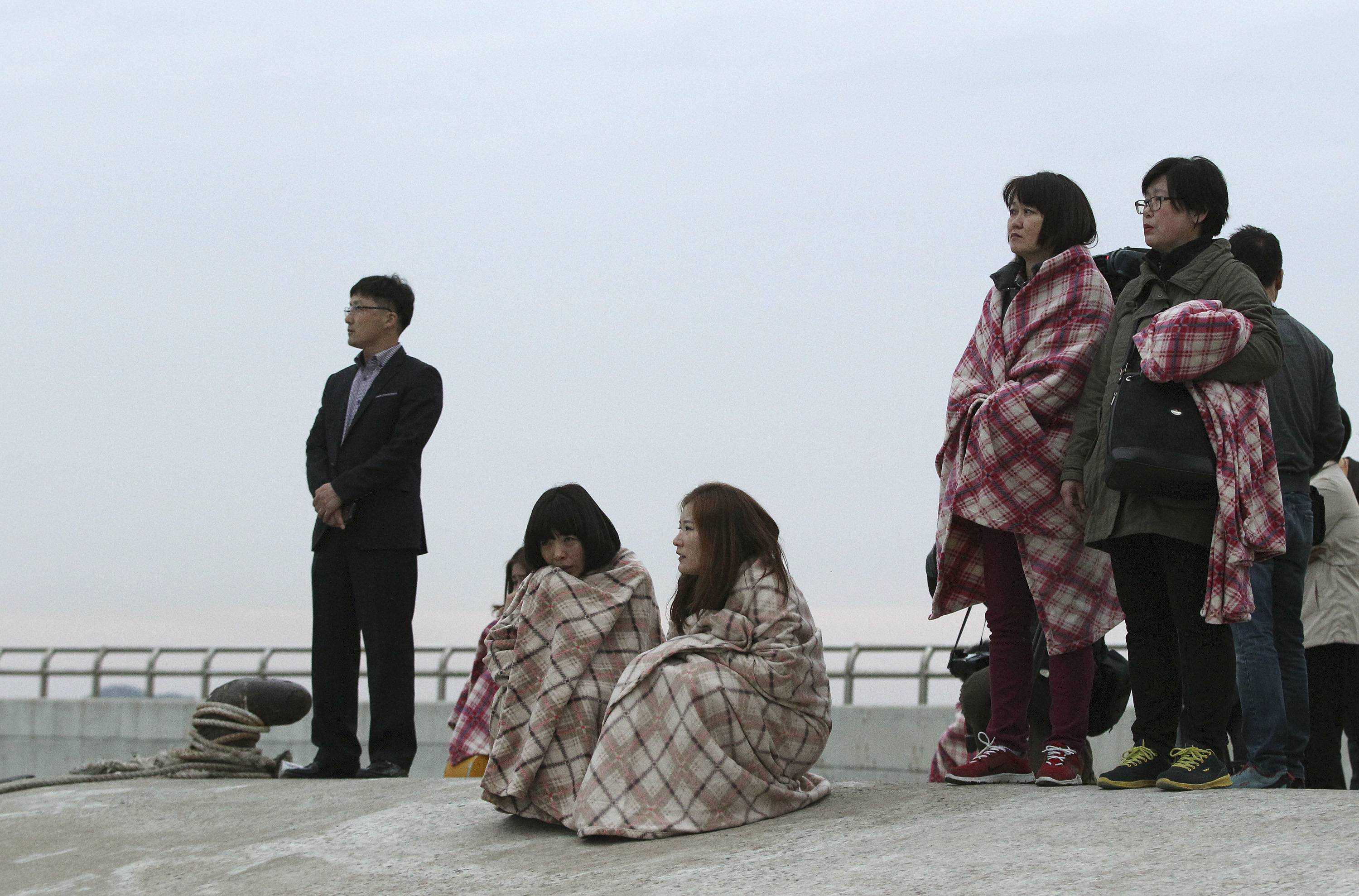 Relatives wait Wednesday for their missing loved ones at a port in Jindo, South Korea. A ferry carrying 475 people, mostly high school students on an overnight trip to a tourist island, sank off South Korea's southern coast on Wednesday, leaving nearly 300 people missing despite a frantic, hourslong rescue by dozens of ships and helicopters.