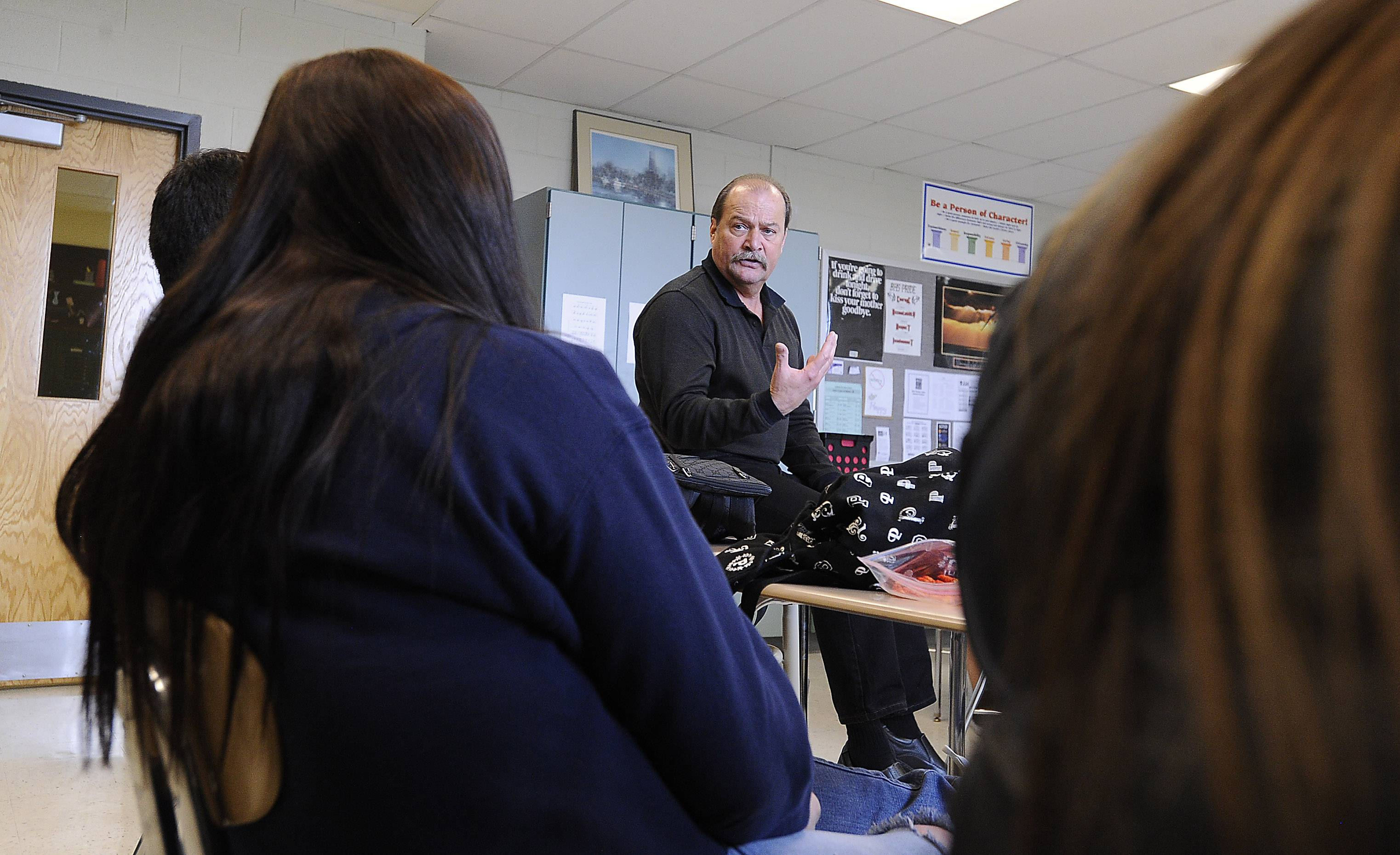 Bill Palmer teaches his Resources in Interpersonal Communications class at Barrington High School. Palmer works with some students from the time they are freshmen through graduation.