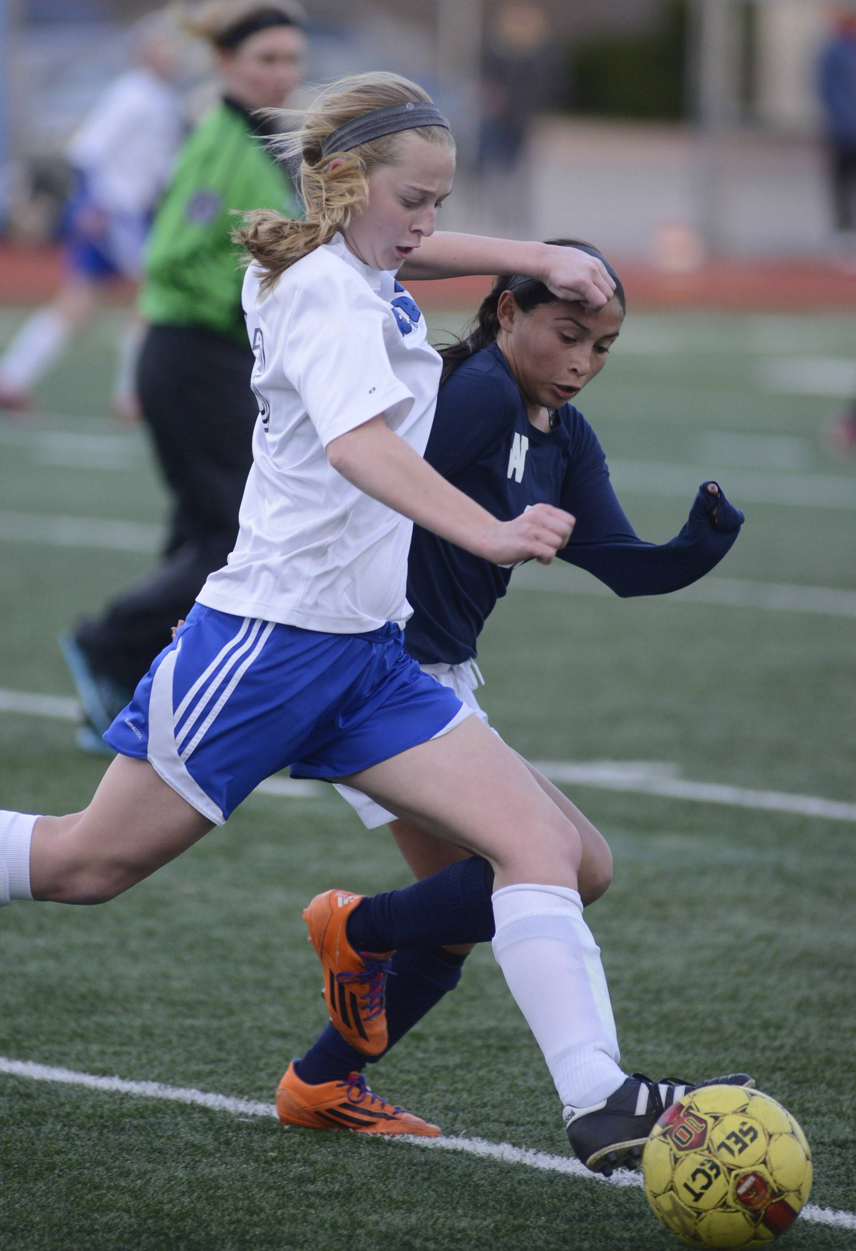 Rosary's Maria Witte, left, and West Aurora's Jocelyn Ferrar fight for the ball in the first half on Wednesday, April 16.