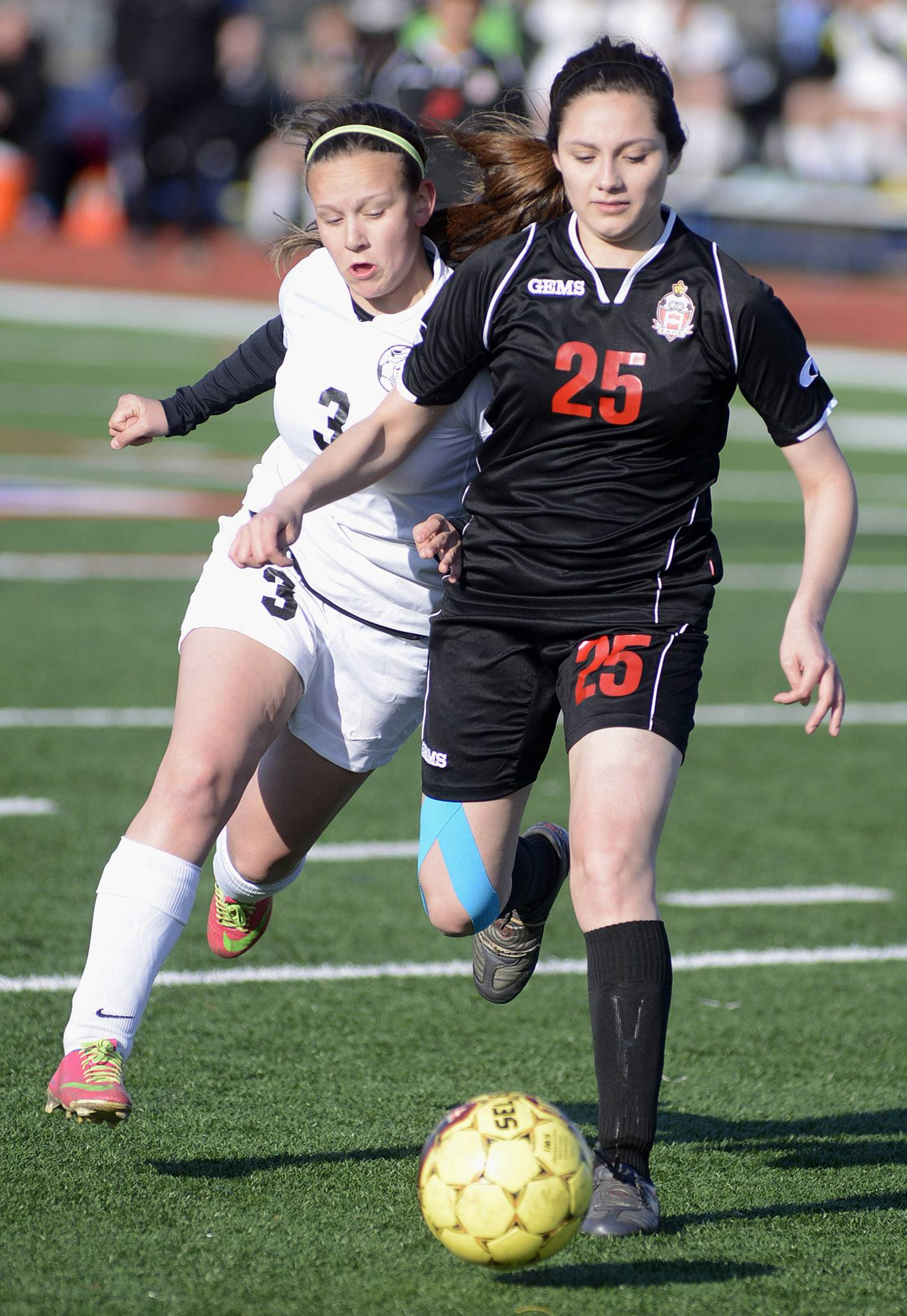 Kaneland's Ashley Crotteau, left, and East Aurora's Rita Oceguera in the second half on Wednesday, April 16.