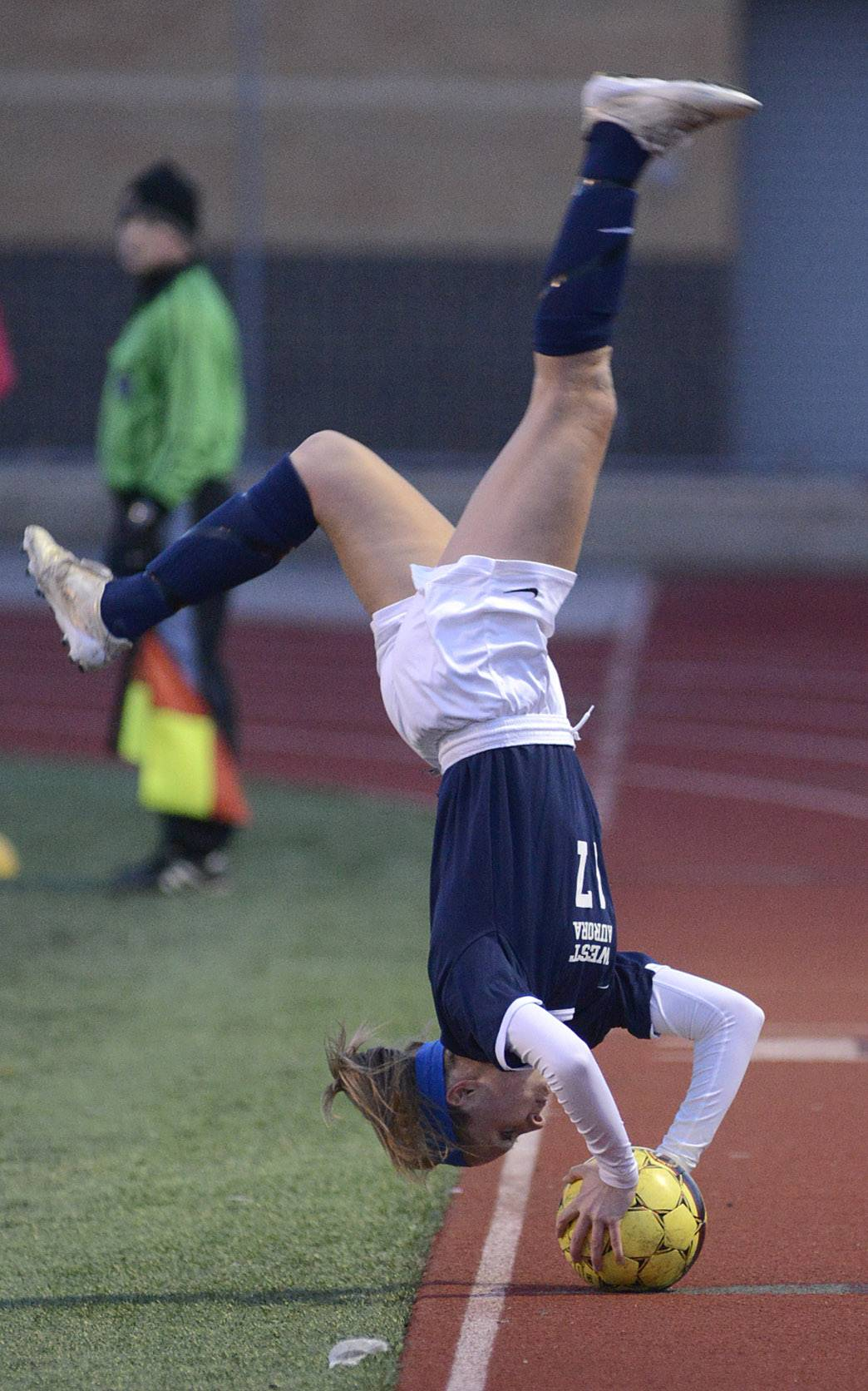 West Aurora's Sam O'Brien throws in the ball via somersault in the second half on Wednesday, April 16.